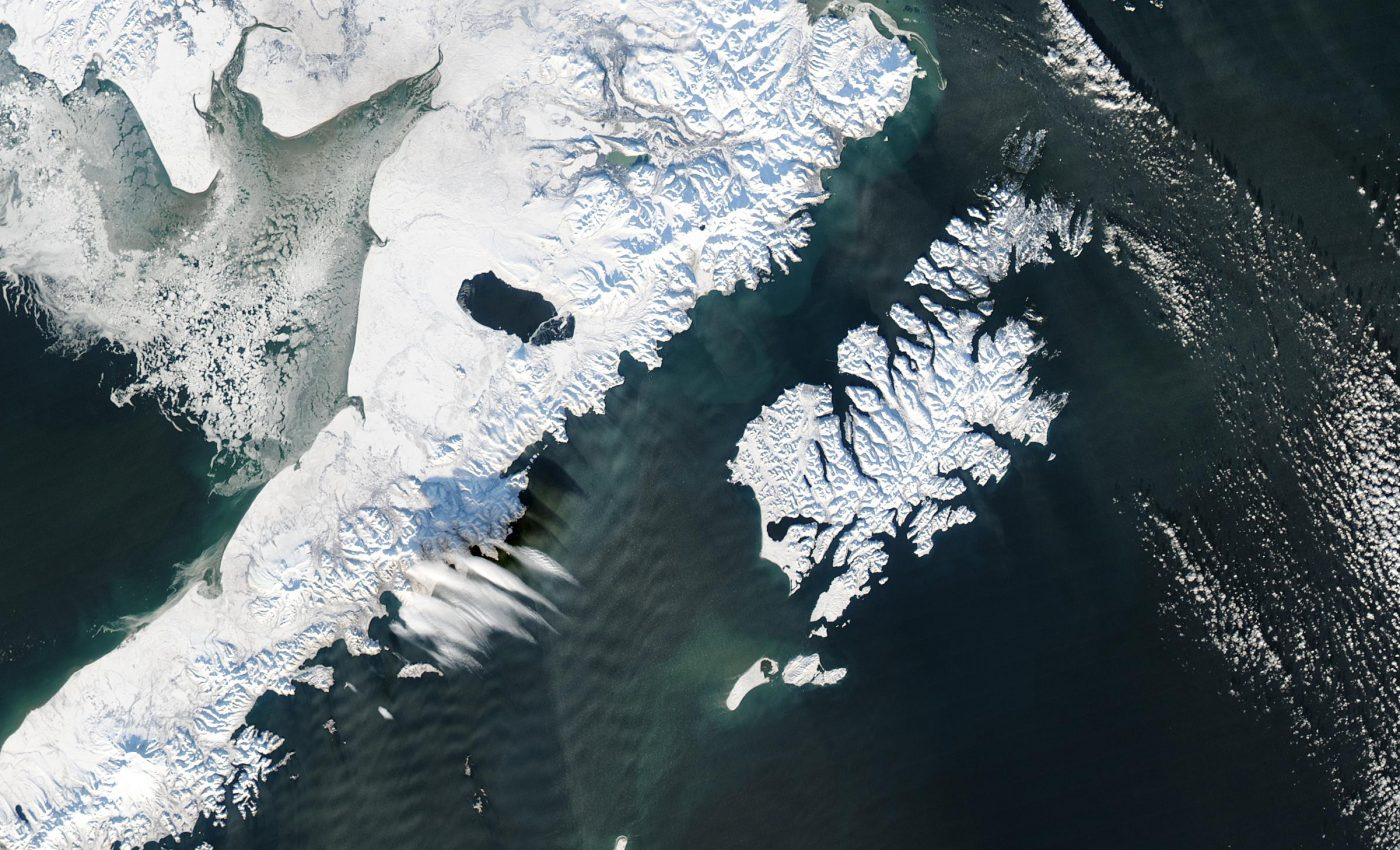 Gravity Waves Across A Streamer of Snow off Alaska