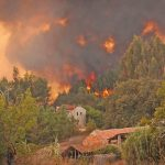 Wildfires burn houses in Portugal during the summer of 2016