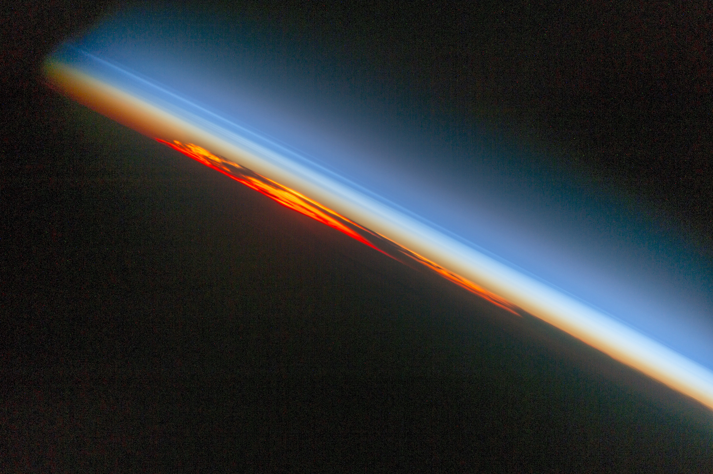 An astronaut aboard the International Space Station photographed a fiery sunset that looks like a vast sheet of flame.