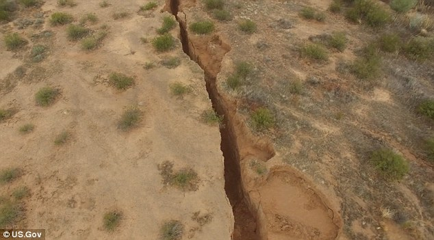Researchers with the Arizona Geological Survey investigated a massive fissure in the Arizona desert using a drone.