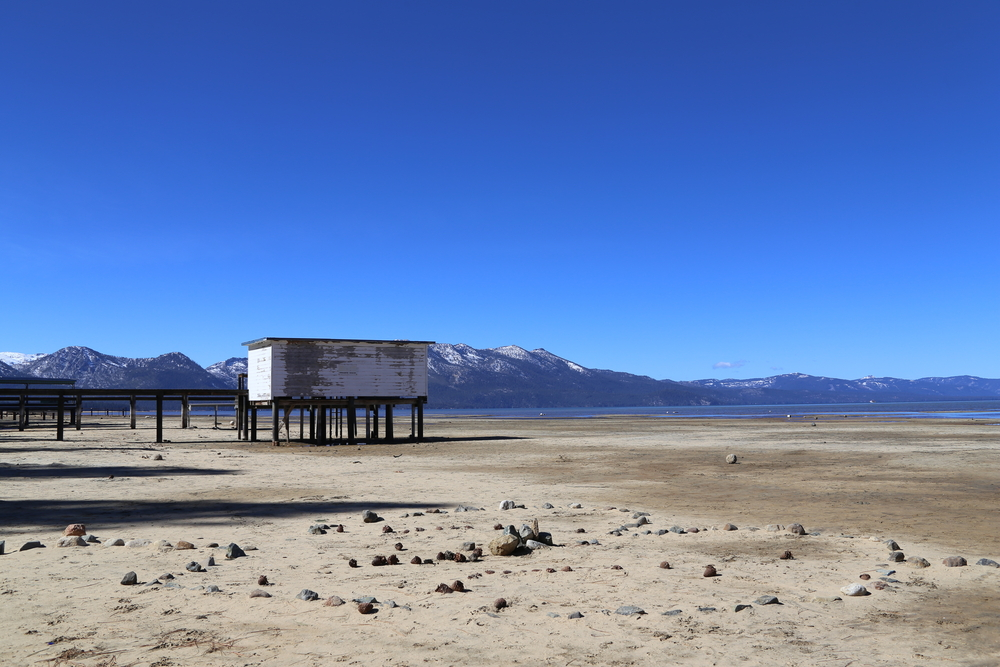 """Drought leaves docks high and dry in South Lake Tahoe, California. Scientists have linked extreme weather to """"stalling"""" planetary airstreams."""