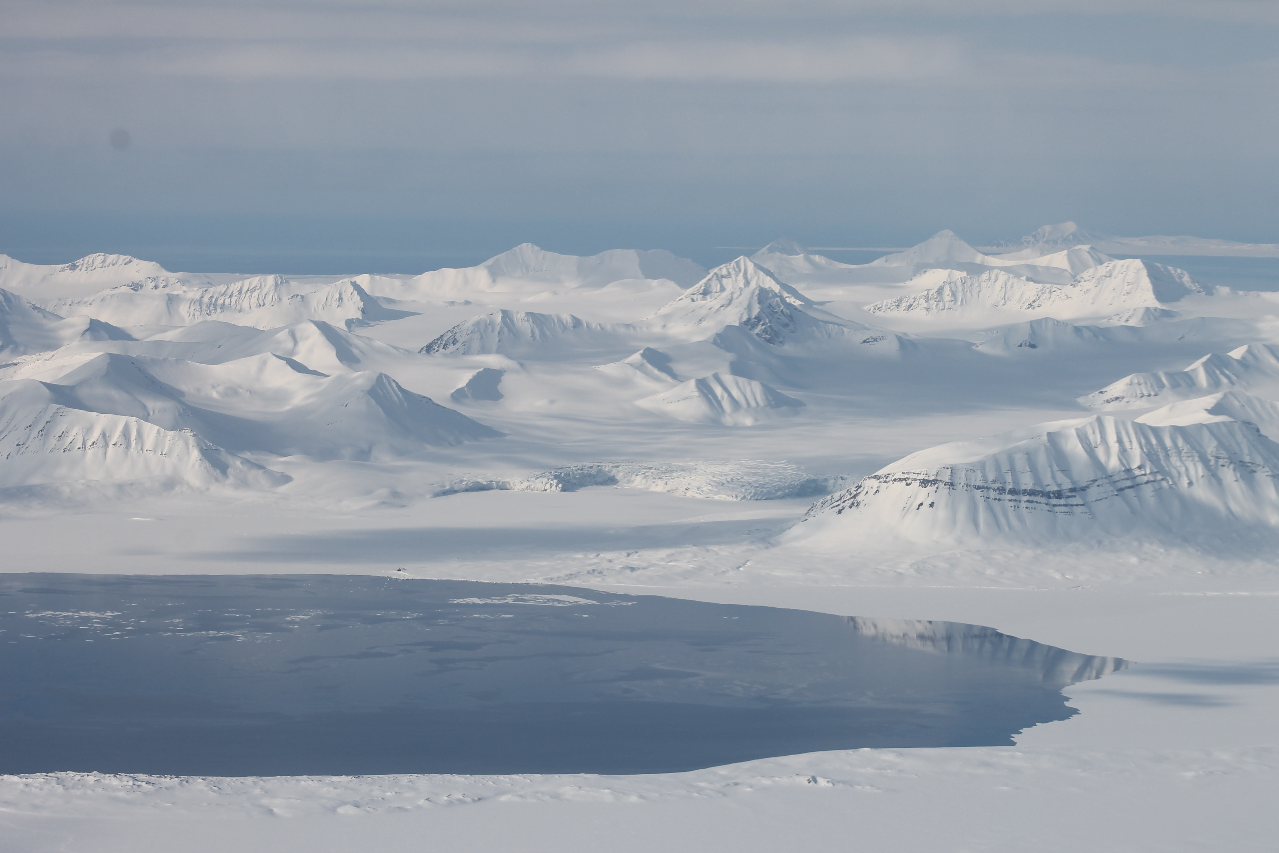 Svalbard, in the Arctic, has undergone substantial warming in recent decades. Retreating glaciers have exposed soil and increased microbial activity.