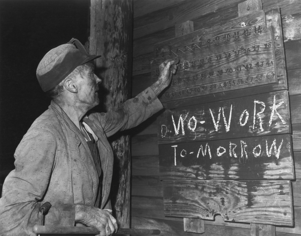 A coal loader marks his check at the end of day's work on Friday, Sept. 13, 1946 in Harlan County, Kentucky. The Kentucky Coal Mining Museum may be a repository of coal mining history, but it installed solar panels to cut costs last week.
