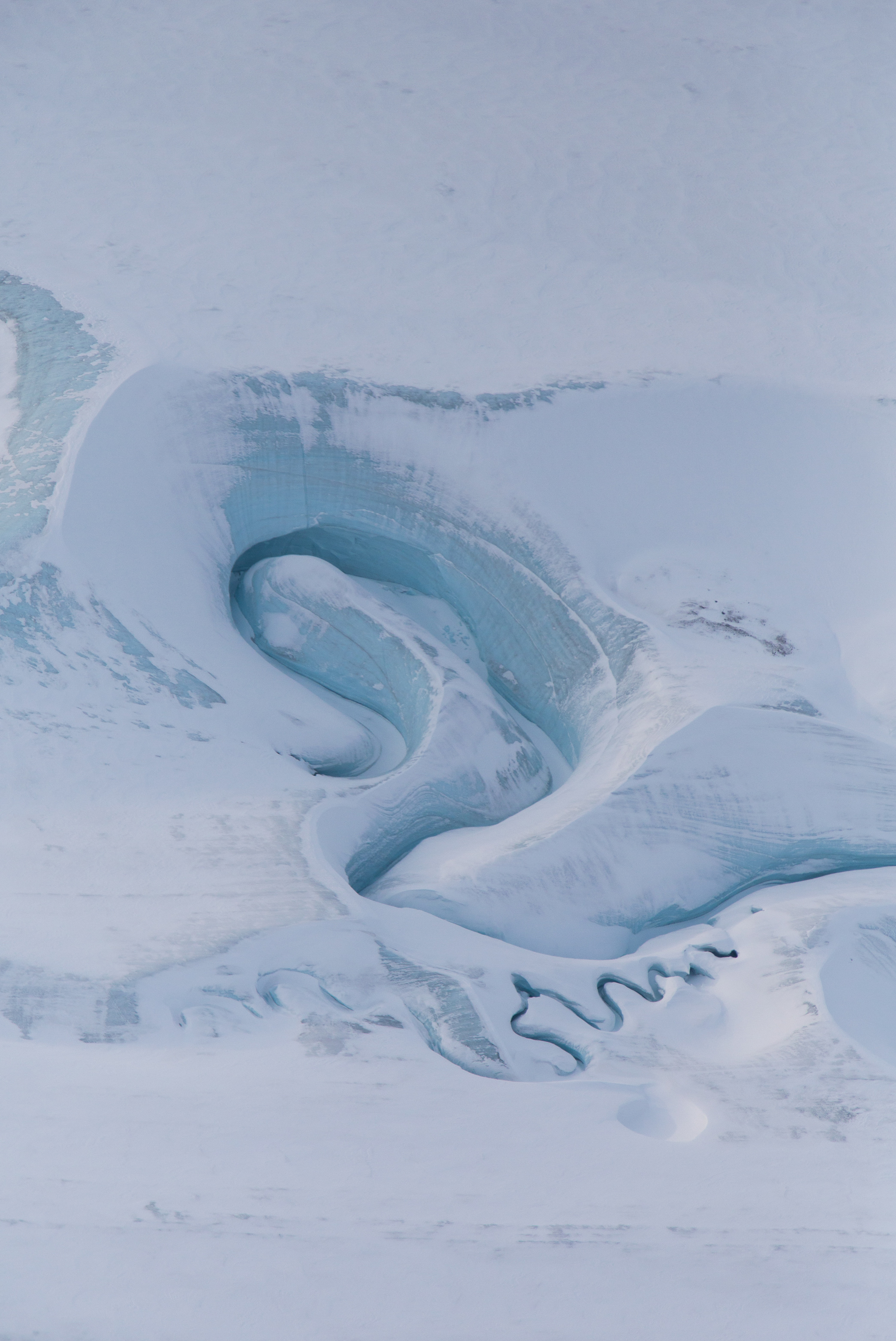 Today's Image of the Day comes from NASA and features a look at meltwater channels on Ellesmere Island in the Canadian Arctic Archipelago.