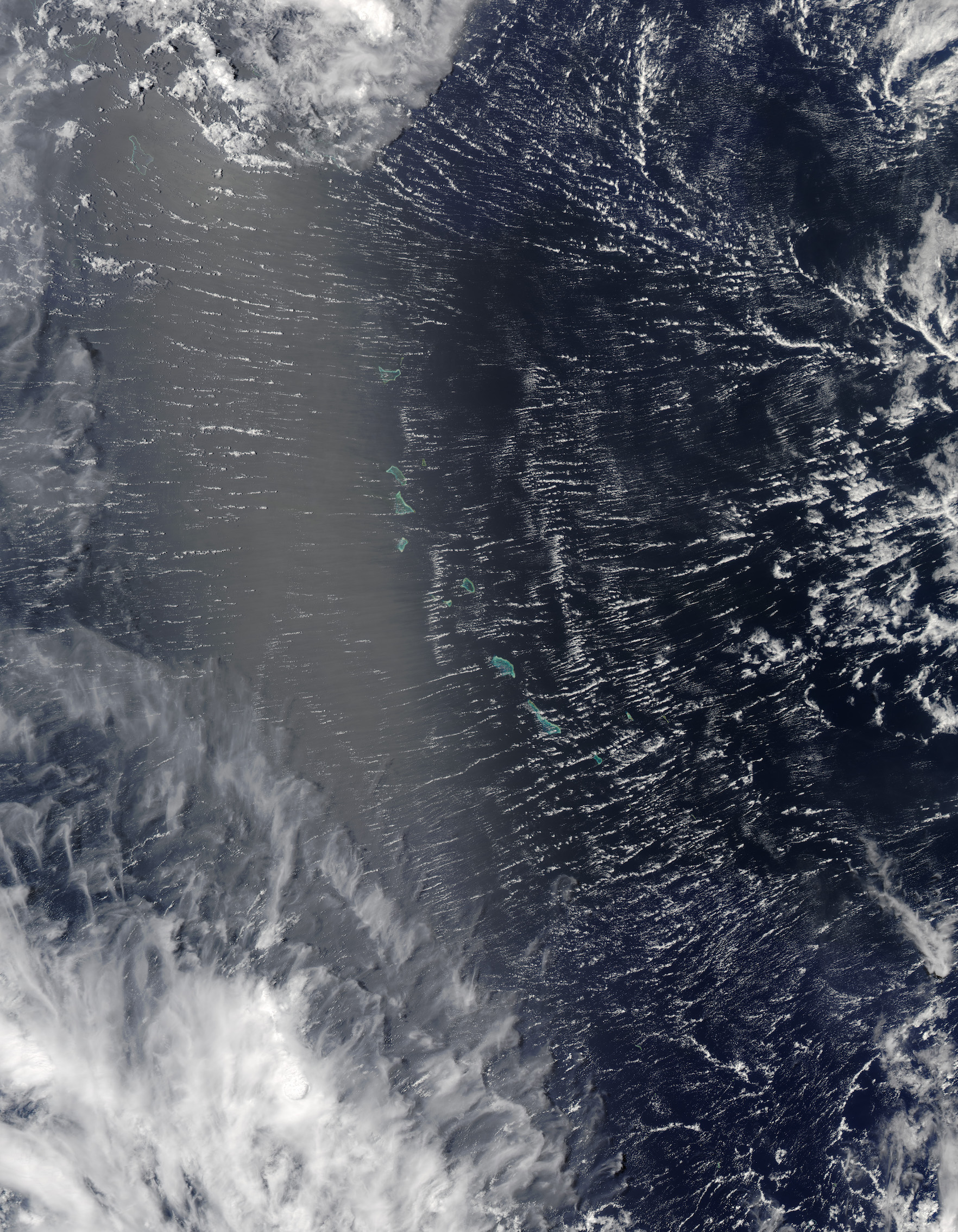 Today's Image of the Day comes courtesy of the NASA Earth Observatory and features a roll clouds covering the Pacific Atolls.