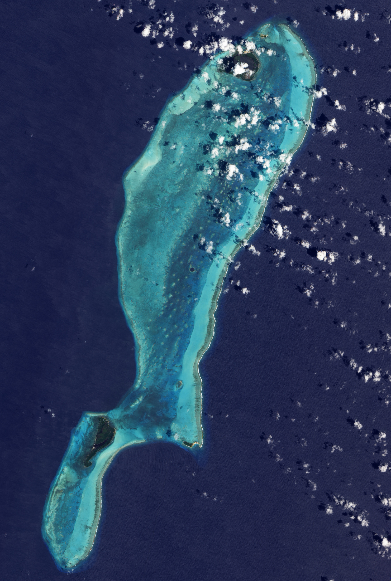 Today's Image of the Day comes from the NASA Earth Observatory and features a look at Belize's beautiful Lighthouse Reef atoll.