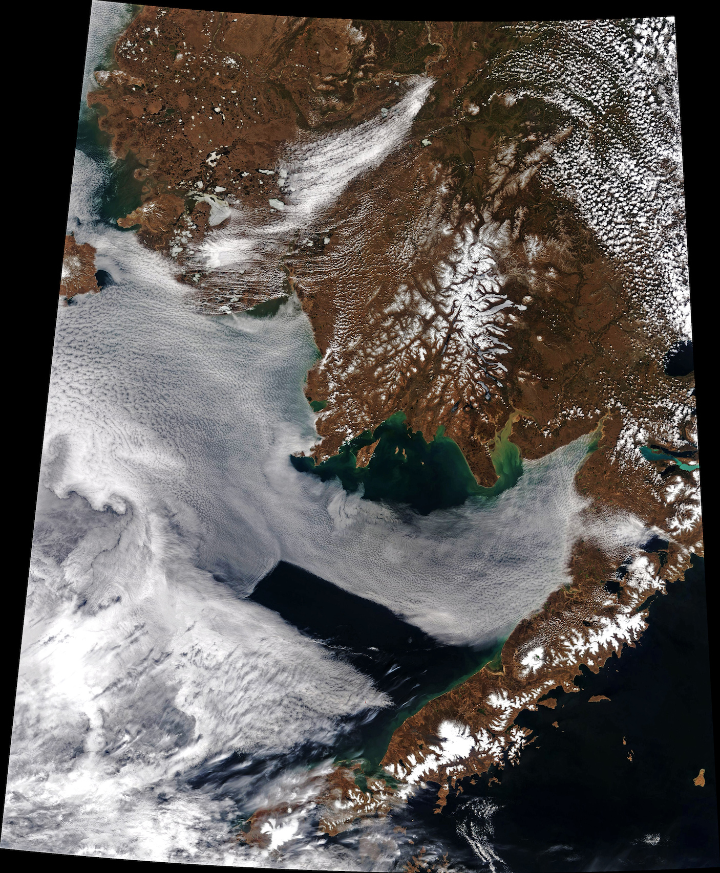 Today's Image of the Day comes thanks to the NASA Earth Observatory and features a look at wave clouds rolling over Bristol Bay in southwestern Alaska.