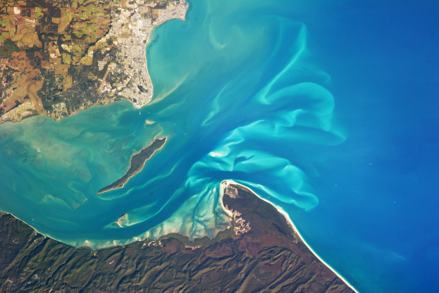 Today's Image of the Day comes thanks to the NASA Earth Observatory and features a look at at the beautiful Hervey Bay in Queensland, Australia.