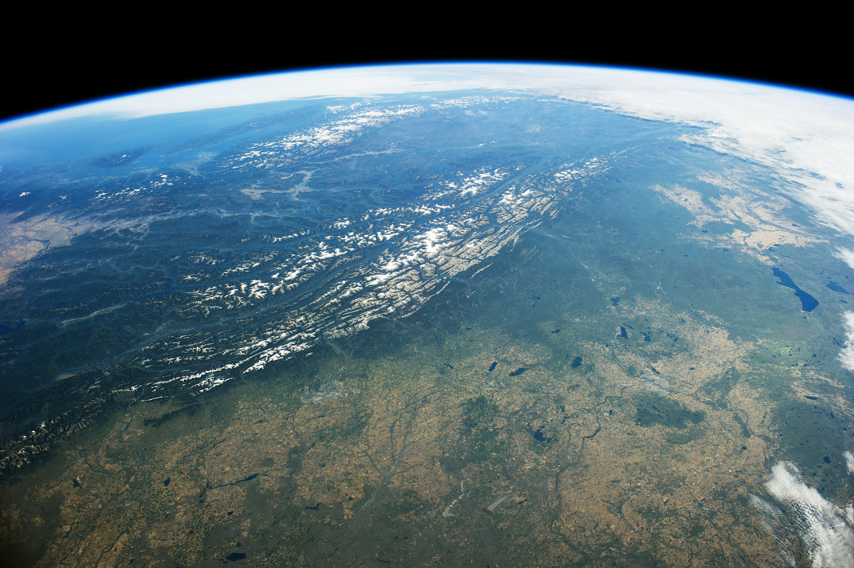 Today's Image of the Day comes thanks to the NASA Earth Observatory and features a look at the Rocky Mountain Trench from the International Space Station.