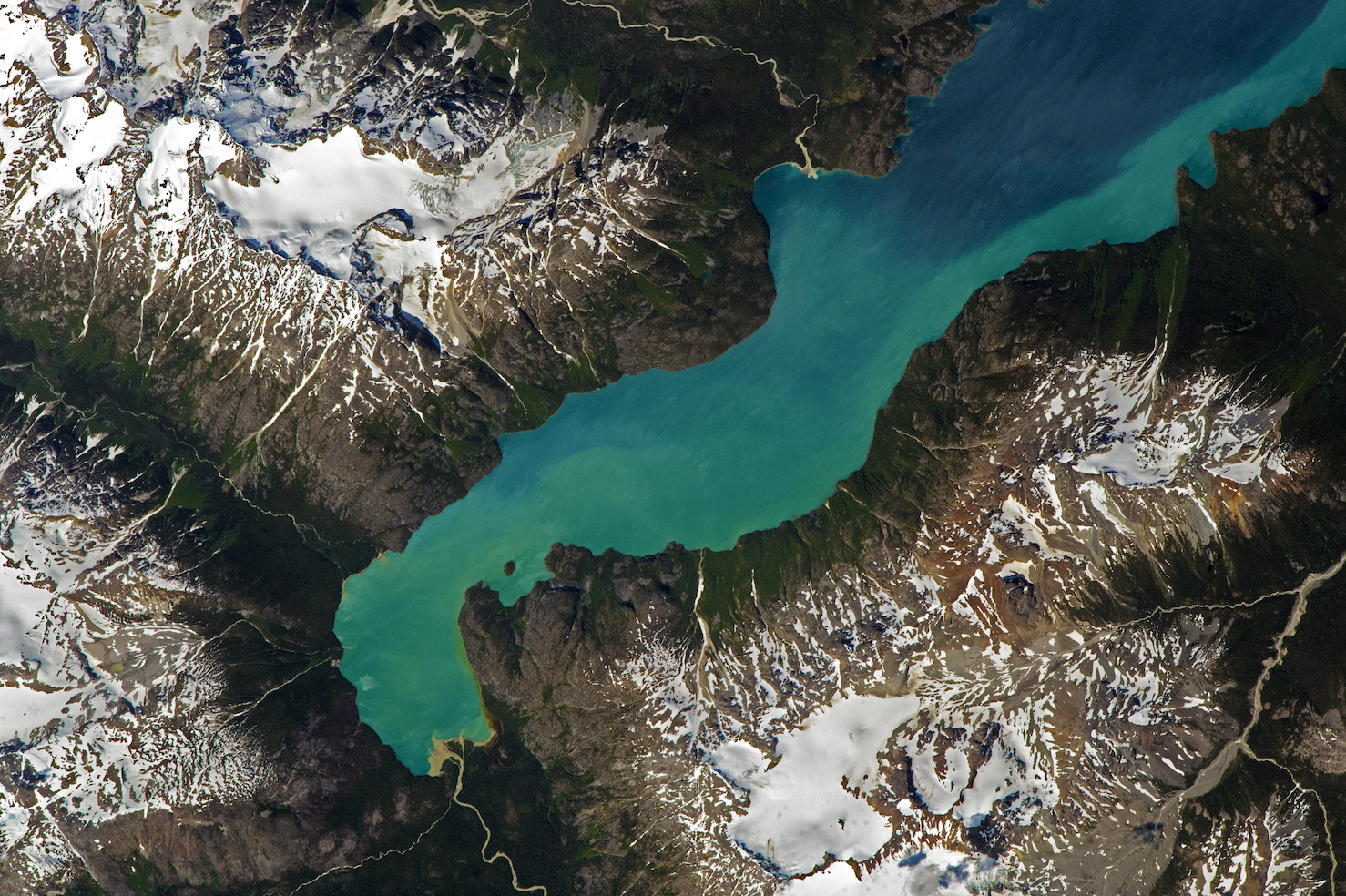 Today's Image of the Day comes thanks to the NASA Earth Observatory and features a look at Chilko Lake in British Columbia.