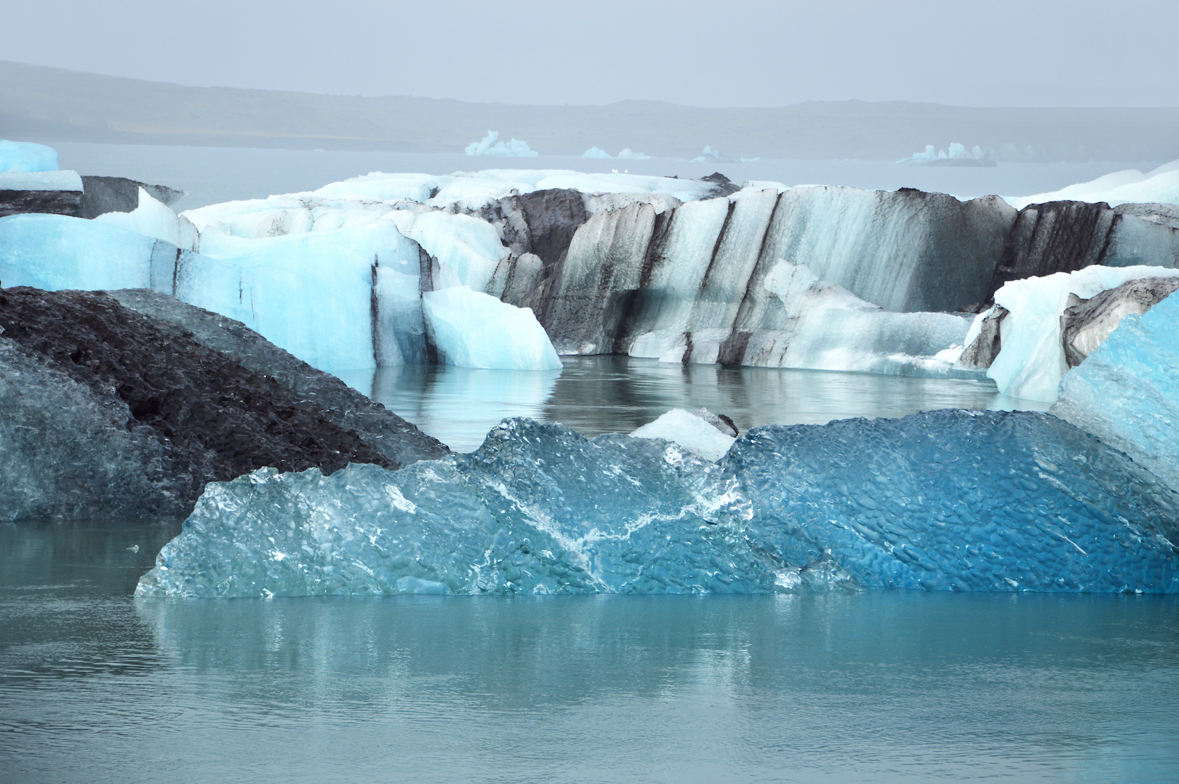 Thawing permafrost soils in the Arctic contribute to the greenhouse effect by releasing methane gas close to the surface and deeply below it.