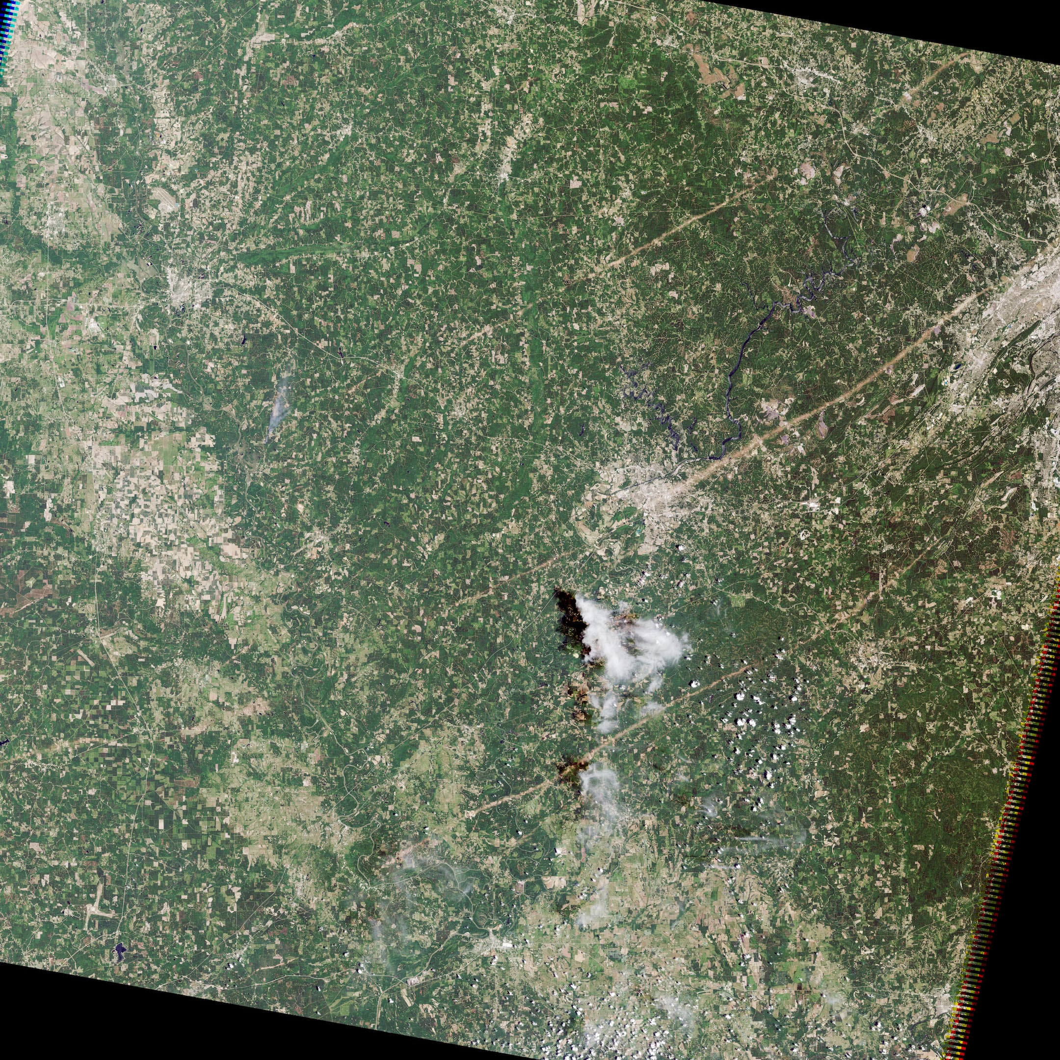 Today's Image of the Day comes thanks to the NASA Earth Observatory and features a look at a tornado track in Tuscaloosa, Alabama.