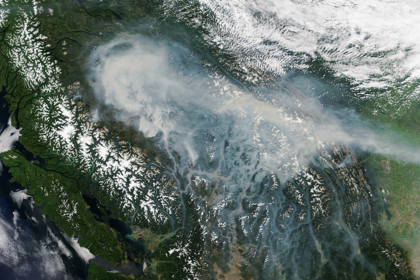 Today's Image of the Day comes thanks to the NASA Earth Observatory and features a look at forest fires burning in British Columbia, Canada.