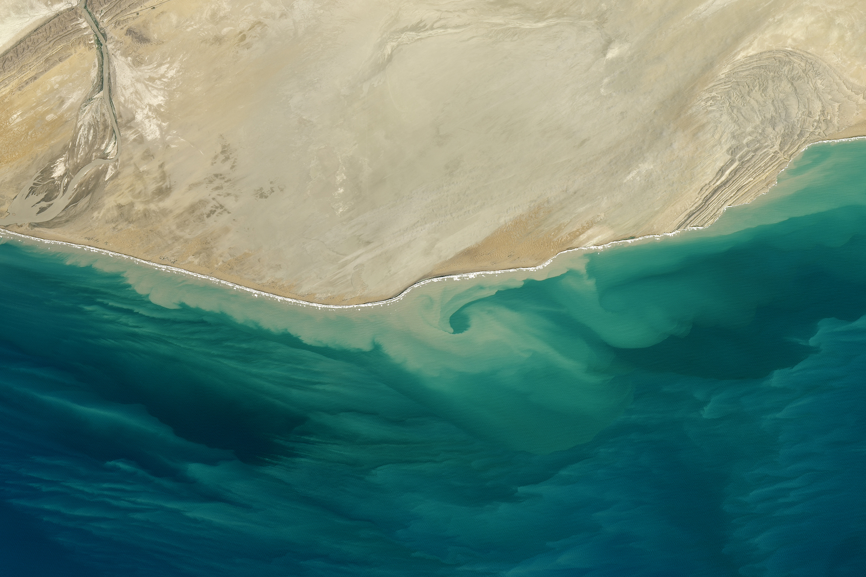Today's Image of the Day comes thanks to the NASA Earth Observatory and features a look at the Makran Coast of Pakistan and the Arabian Sea.