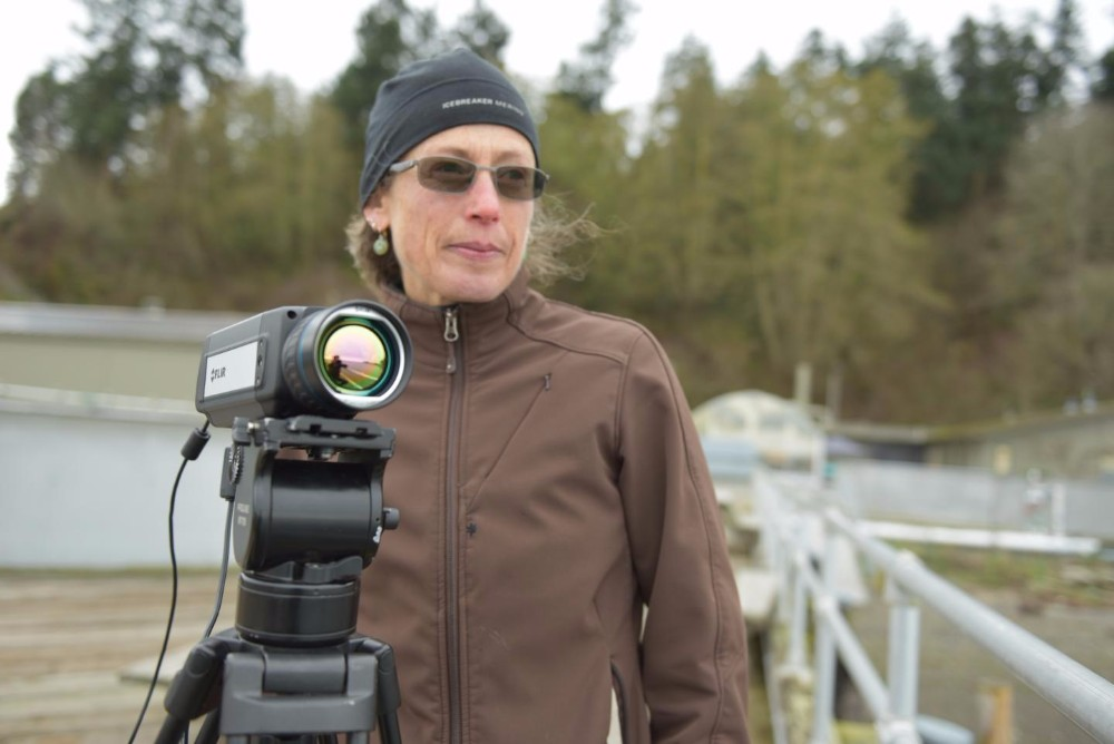 Pacific Northwest National Laboratory's ThermalTracker software has adapted thermal imaging used in military tech to help birds and bats near offshore wind farms. Dr. Shari Matzner is shown here with a thermal video camera.