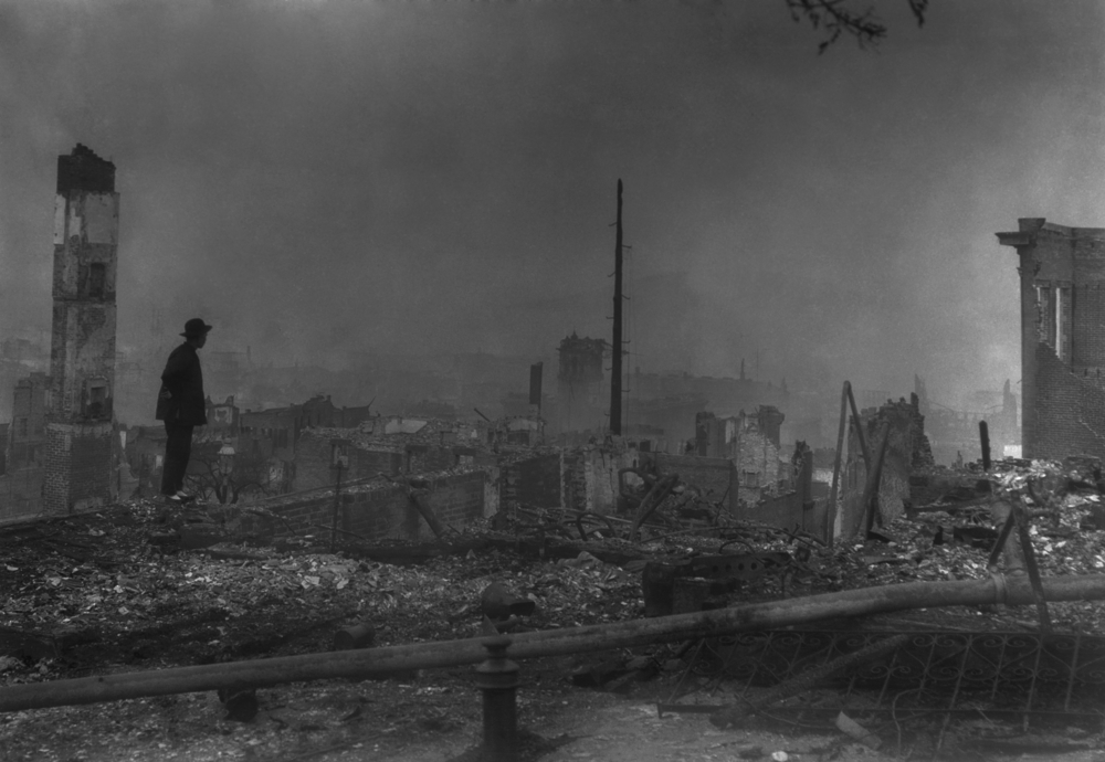 A Chinese-American man surveys the destruction of Chinatown in the 1906 San Francisco earthquake aftermath.