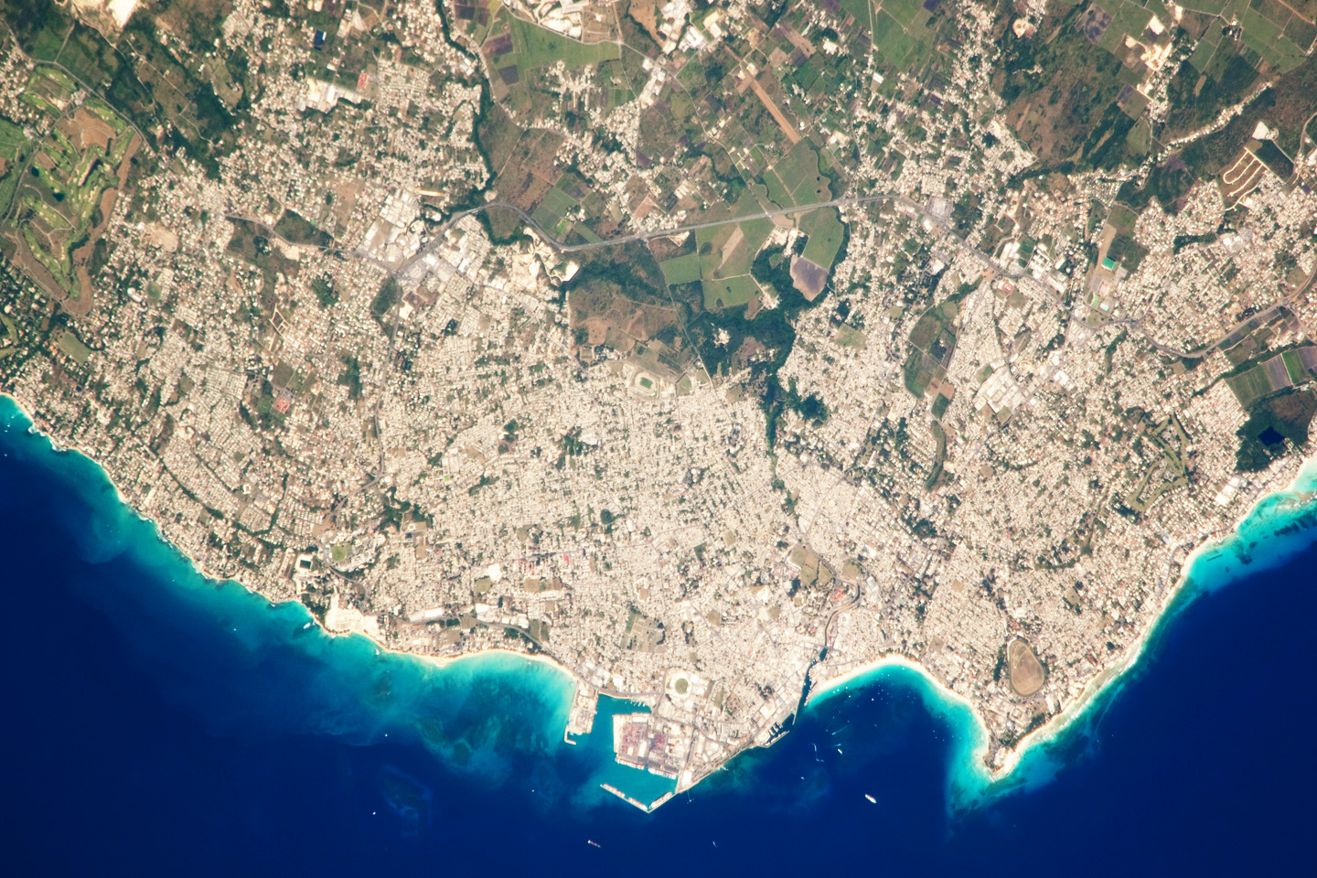 Today's Image of the Day comes thanks to the NASA Earth Observatory and features a look at Bridgetown, Barbados and the Carlisle Bay.