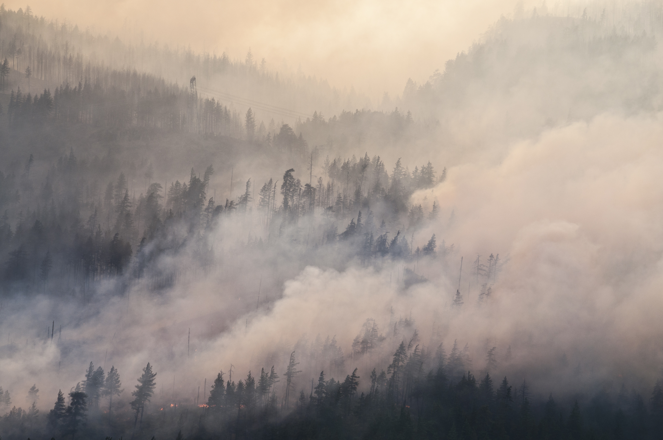 How exactly does smoke from this week's northern California wildfires impact the atmosphere and the effects of climate change?