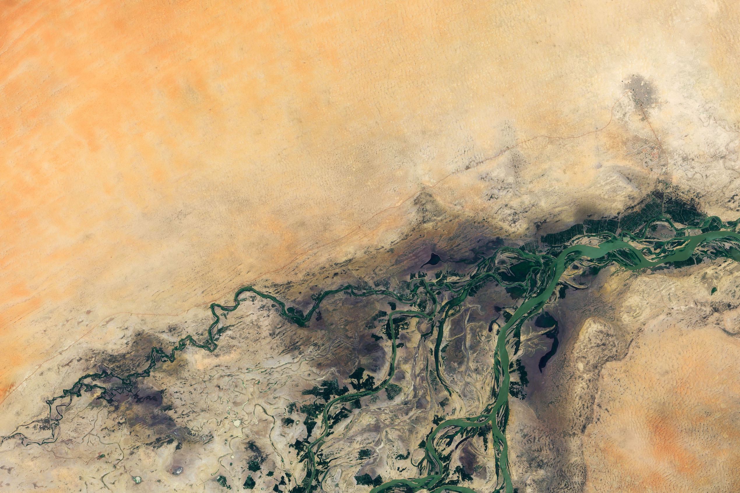 Today's Image of the Day comes thanks to the NASA Earth Observatory and features a look at the city of Timbuktu in the middle of the Sahara Desert.