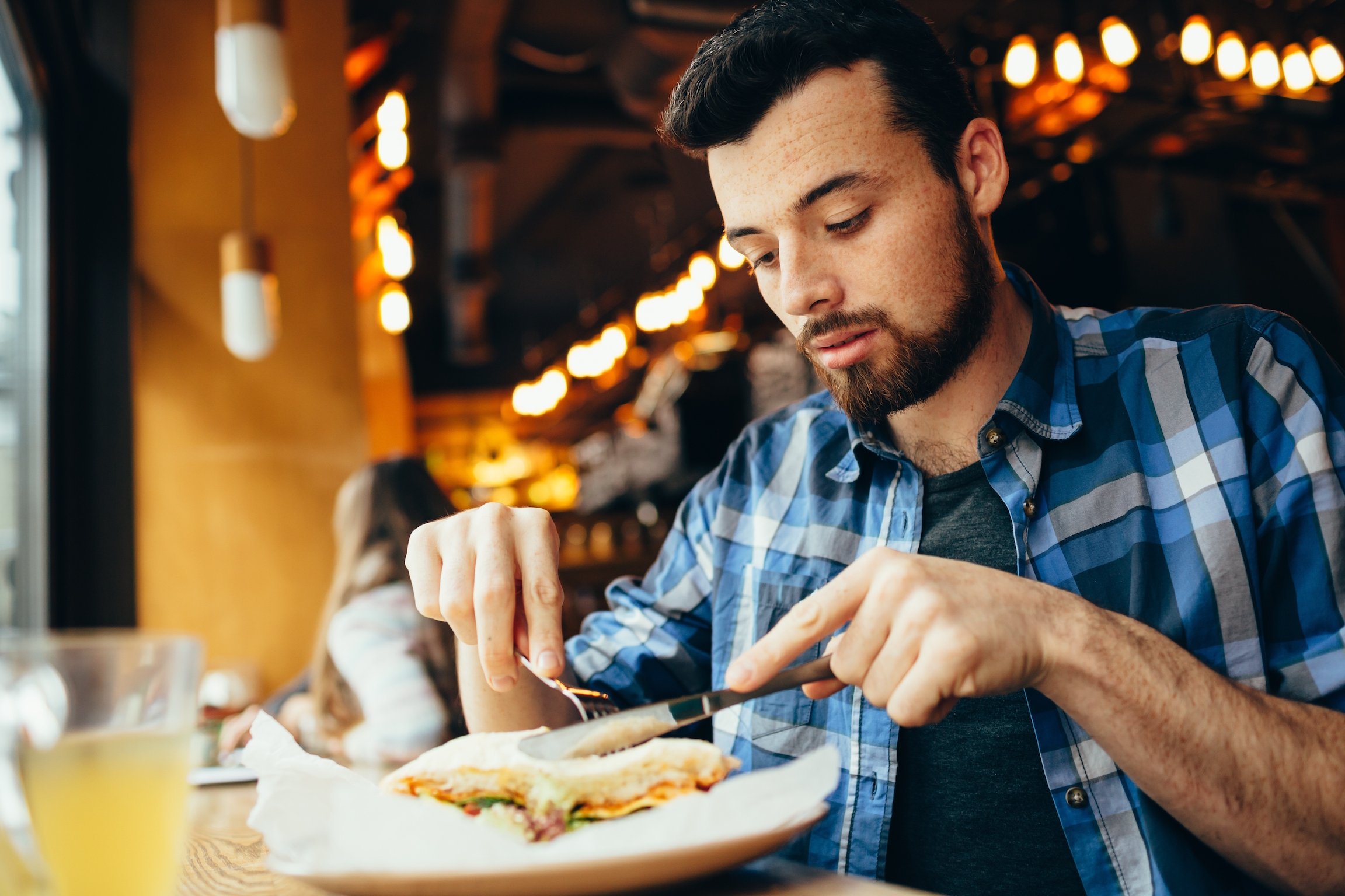 A new study has found that people who eat alone, particularly men, are at an increased risk of developing high cholesterol and obesity.