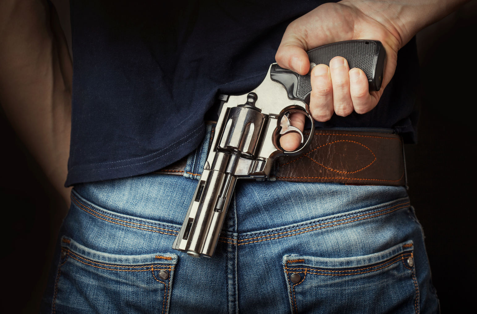 A new study found that white men who are financially stressed are more likely to cling to their guns for moral support.
