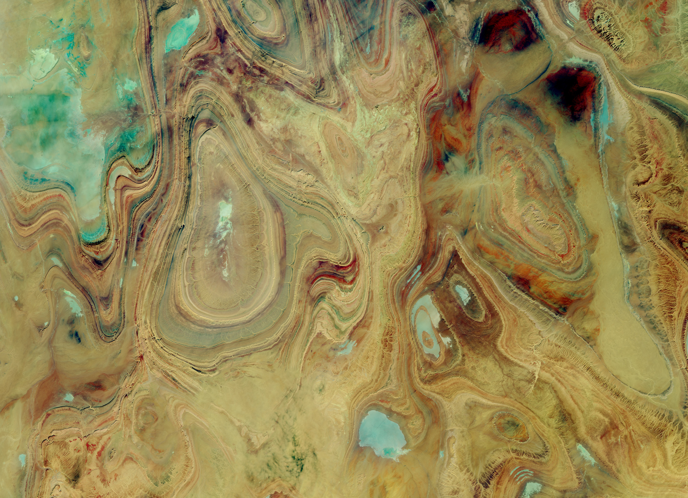 Today's Image of the Day comes courtesy of the NASA Earth Observatory and features a look at the Tanezrouft Basin in central Algeria.