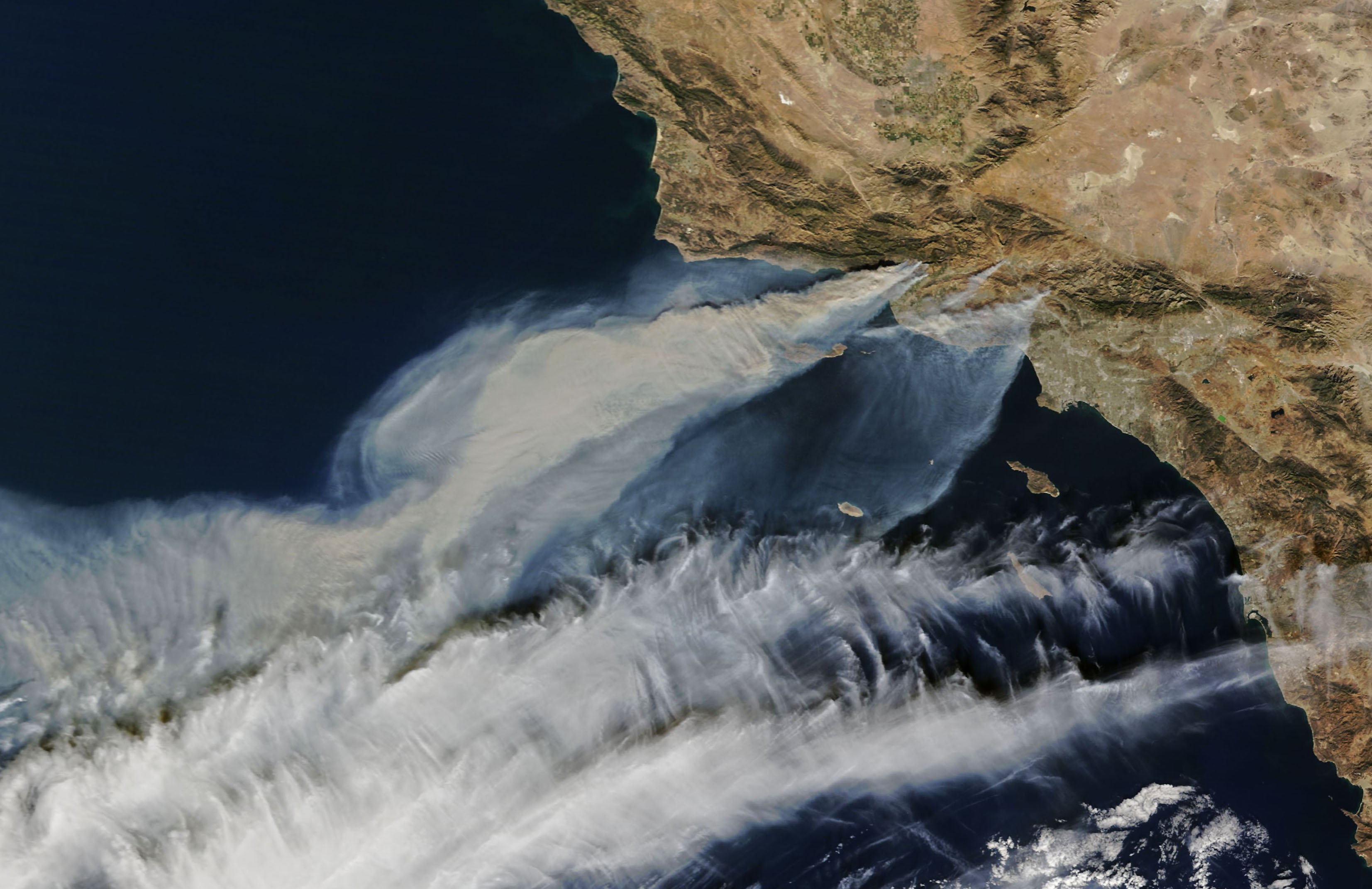 This week, multiple wildfires have burned through Southern California, and today's Image of the Day shows the smoke visible from space.