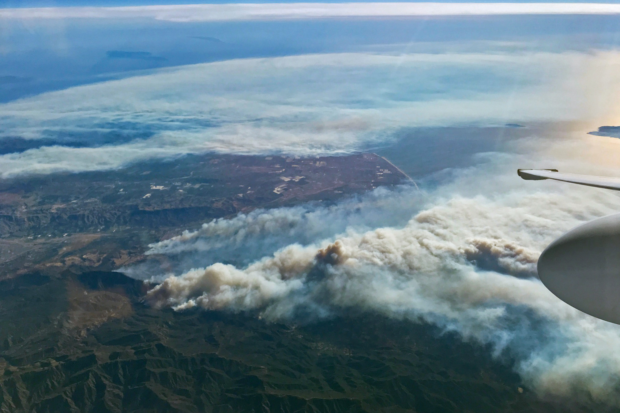 Today's Image of the Day comes from NASA and features a look at thick smoke billowing out of this week's wildfires in Southern California.