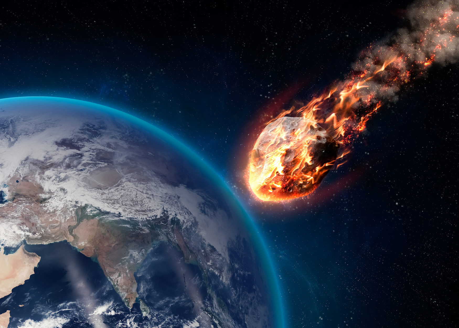 Earth's atmosphere works as a natural shield, and the force of air pushing against the meteoroid causes it to crack and explode.