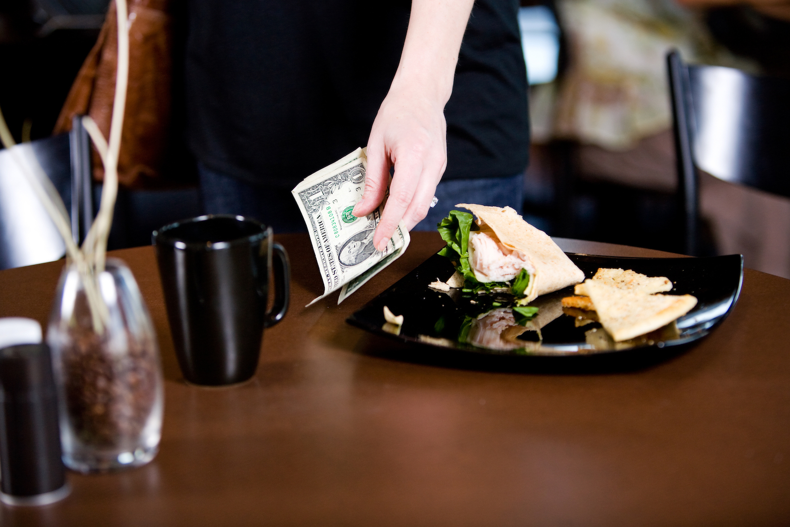 Tipping improves customer satisfaction and allows restaurants to keep menu prices lower than if they had an inclusive pricing system.