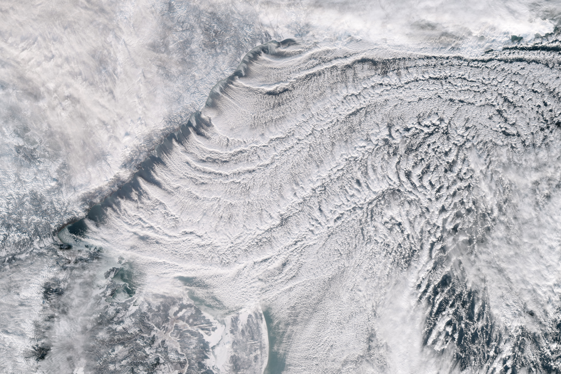 Today's Image of the Day comes from the NASA Earth Observatory and features a look at cloud streets and the Sea of Okhotsk covered in ice.