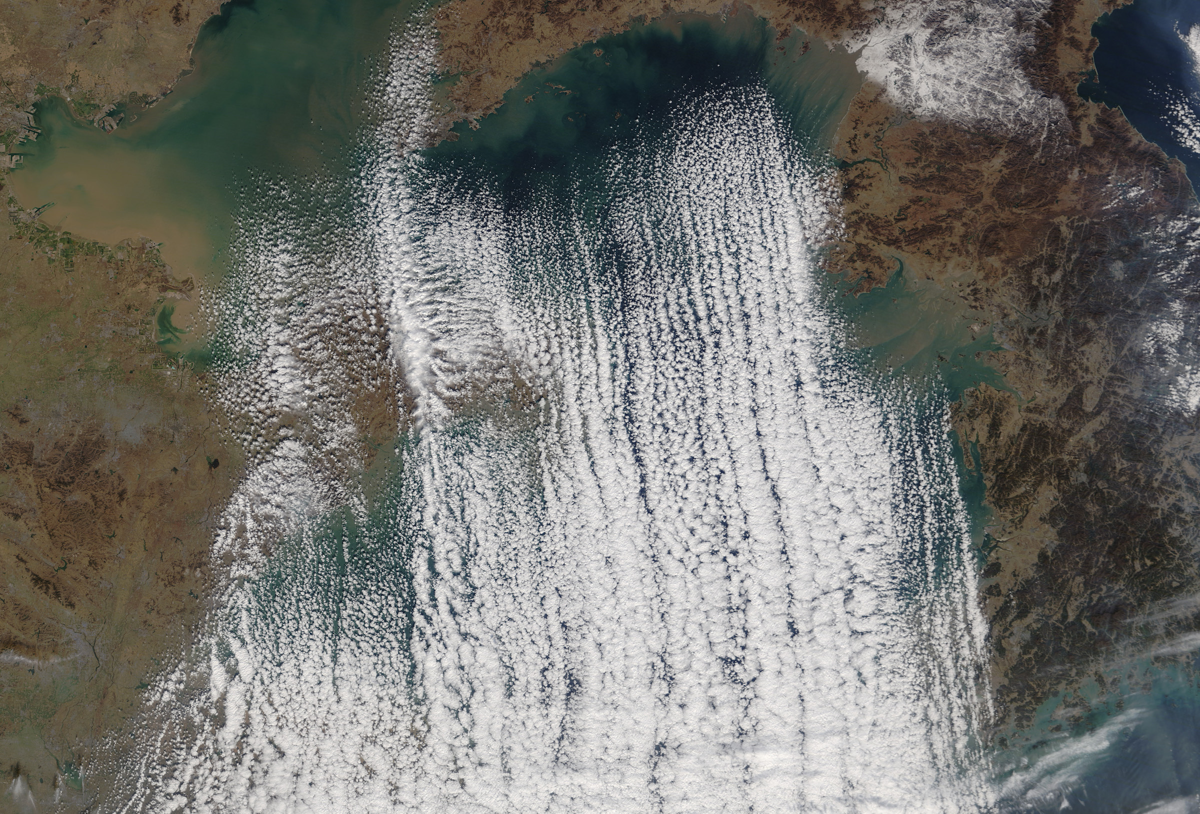 Today's Image of the Day comes from the NASA Earth Observatory and features a look at the Korean Peninsula and cloud streets over the Yellow Sea.