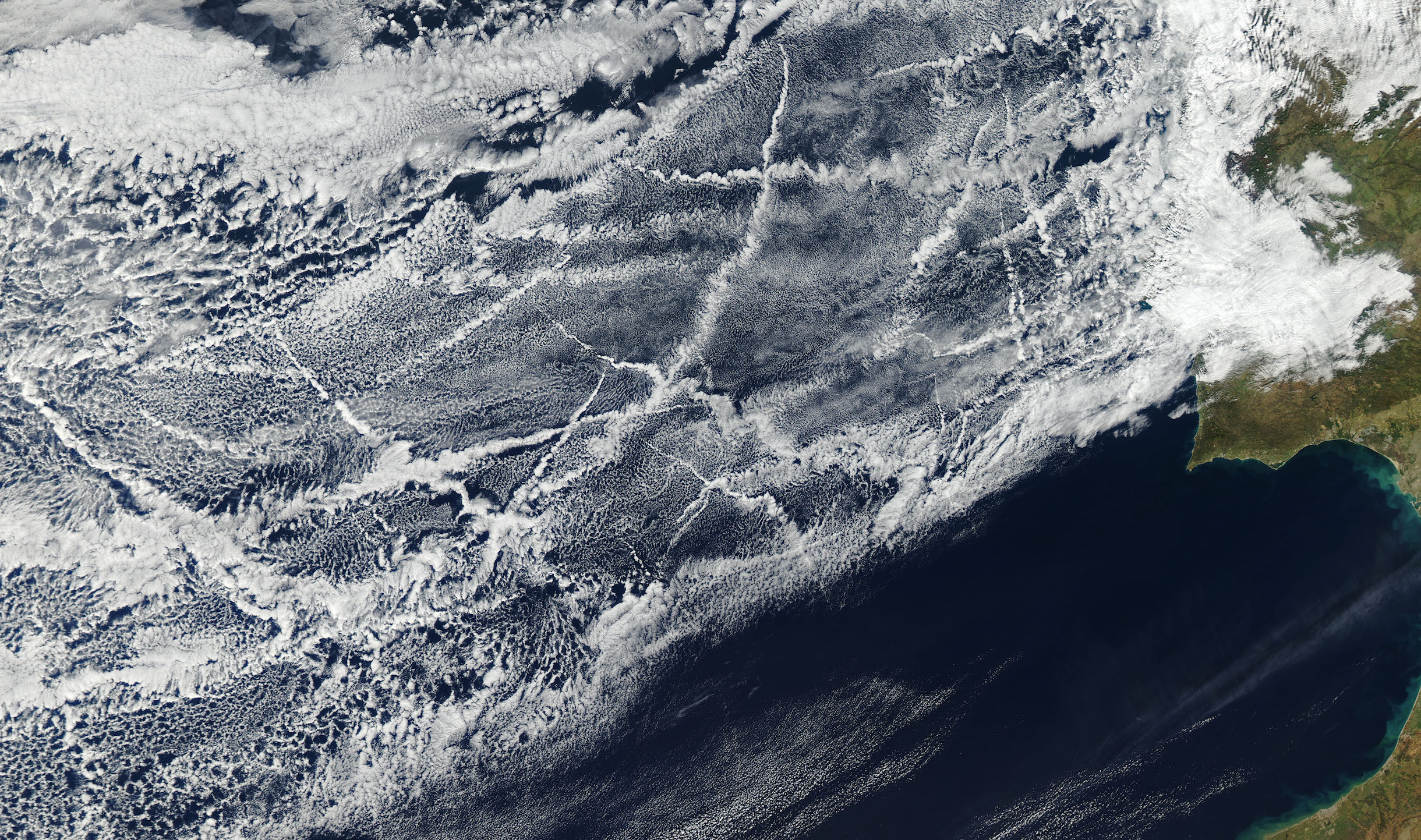 Today's Image of the Day comes from the NASA Earth Observatory and features a look at ship tracks forming in the north Atlantic Ocean.