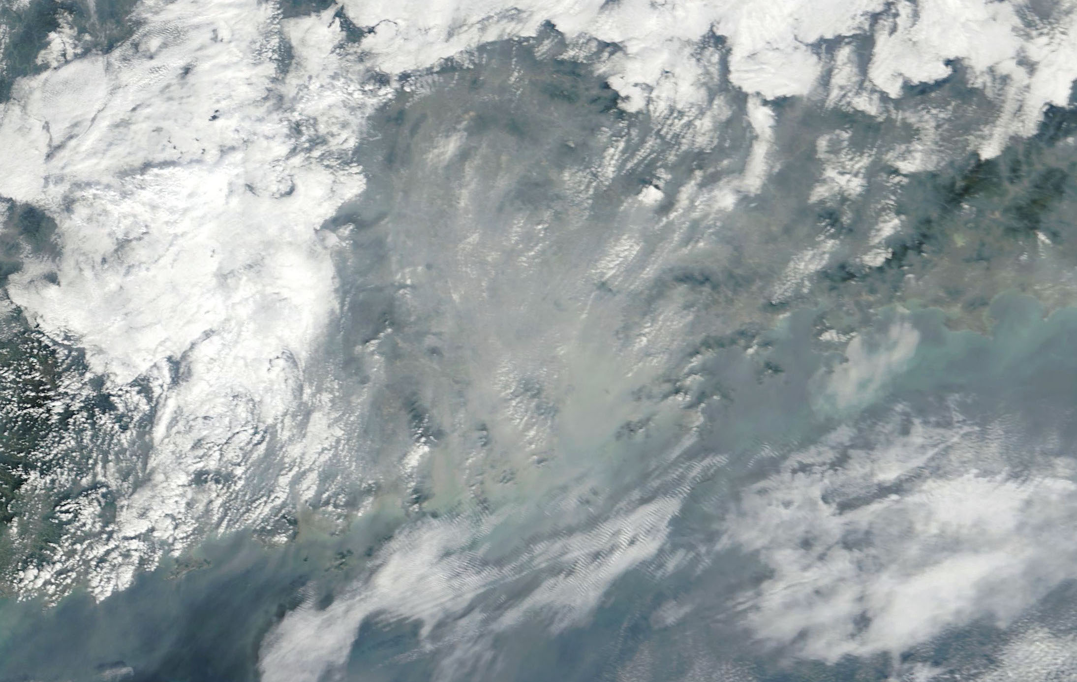 Today's Image of the Day comes from the NASA Earth Observatory and features a look at at heavy air pollution over the Pearl River Delta in southern China.