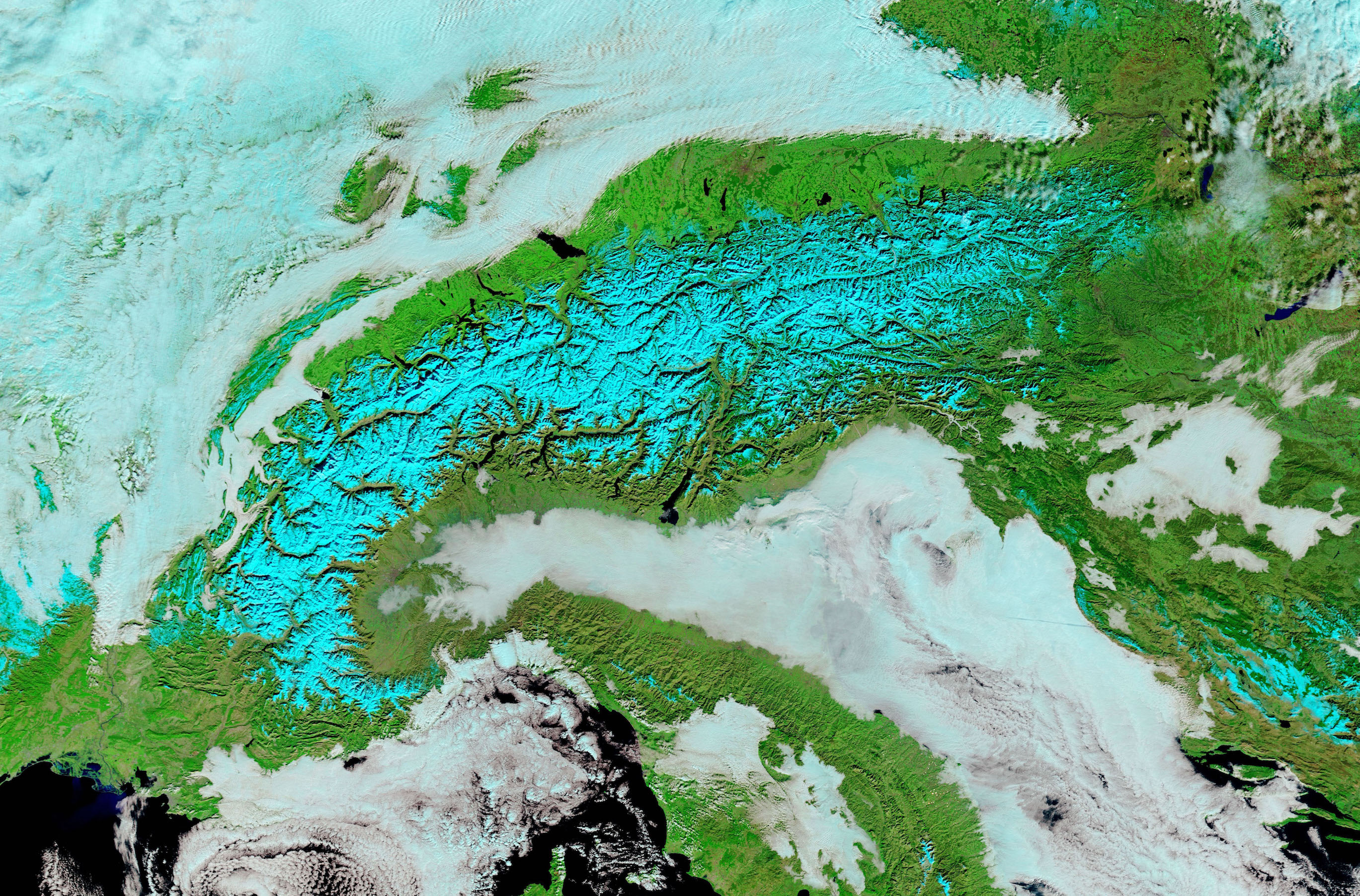 Today's Image of the Day comes from the NASA Earth Observatory and features a look at heavy snow and low clouds in the Alps.