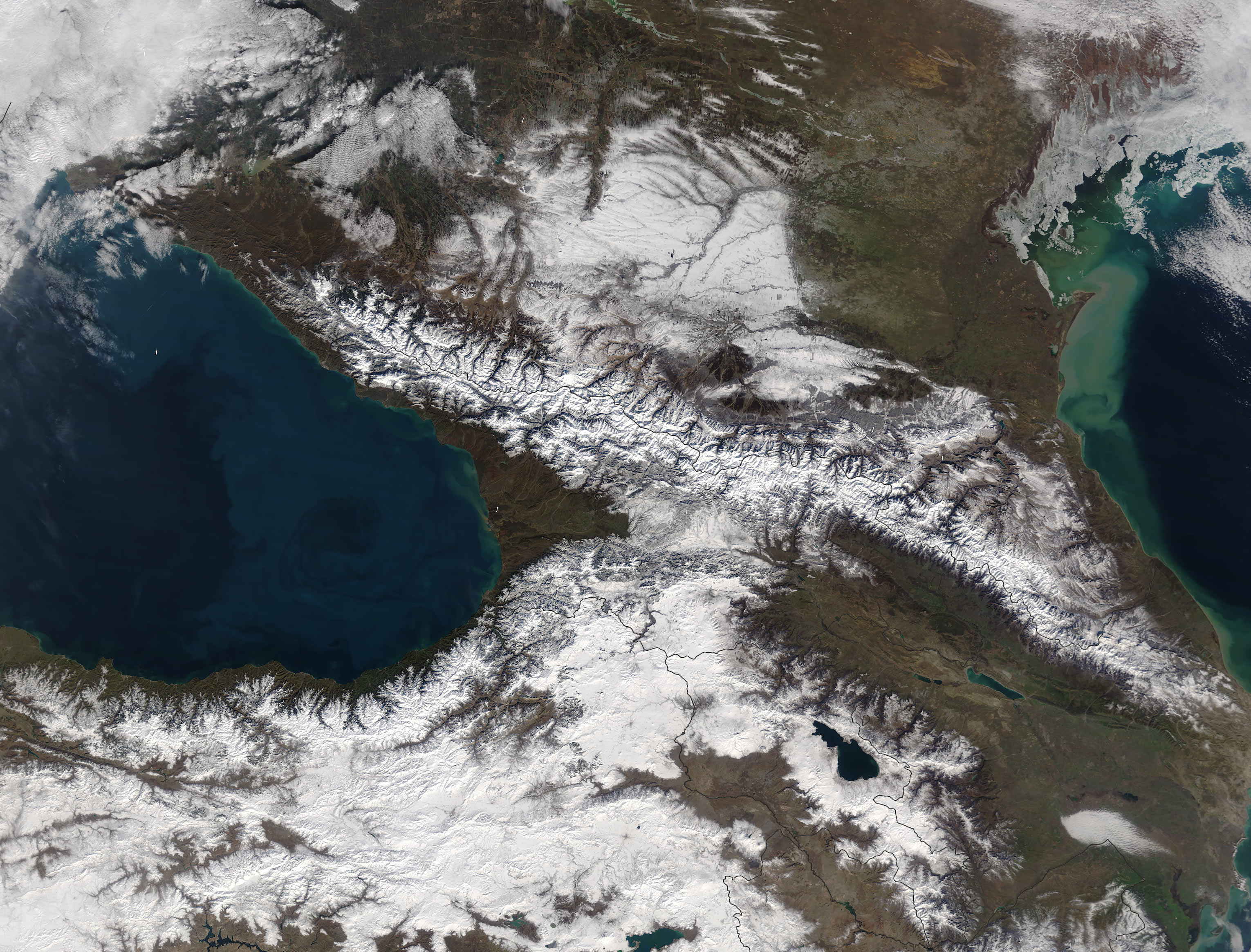 Today's Image of the Day comes from the NASA Earth Observatory and features a look at the snow-covered Caucasus Mountains in Russia during winter.