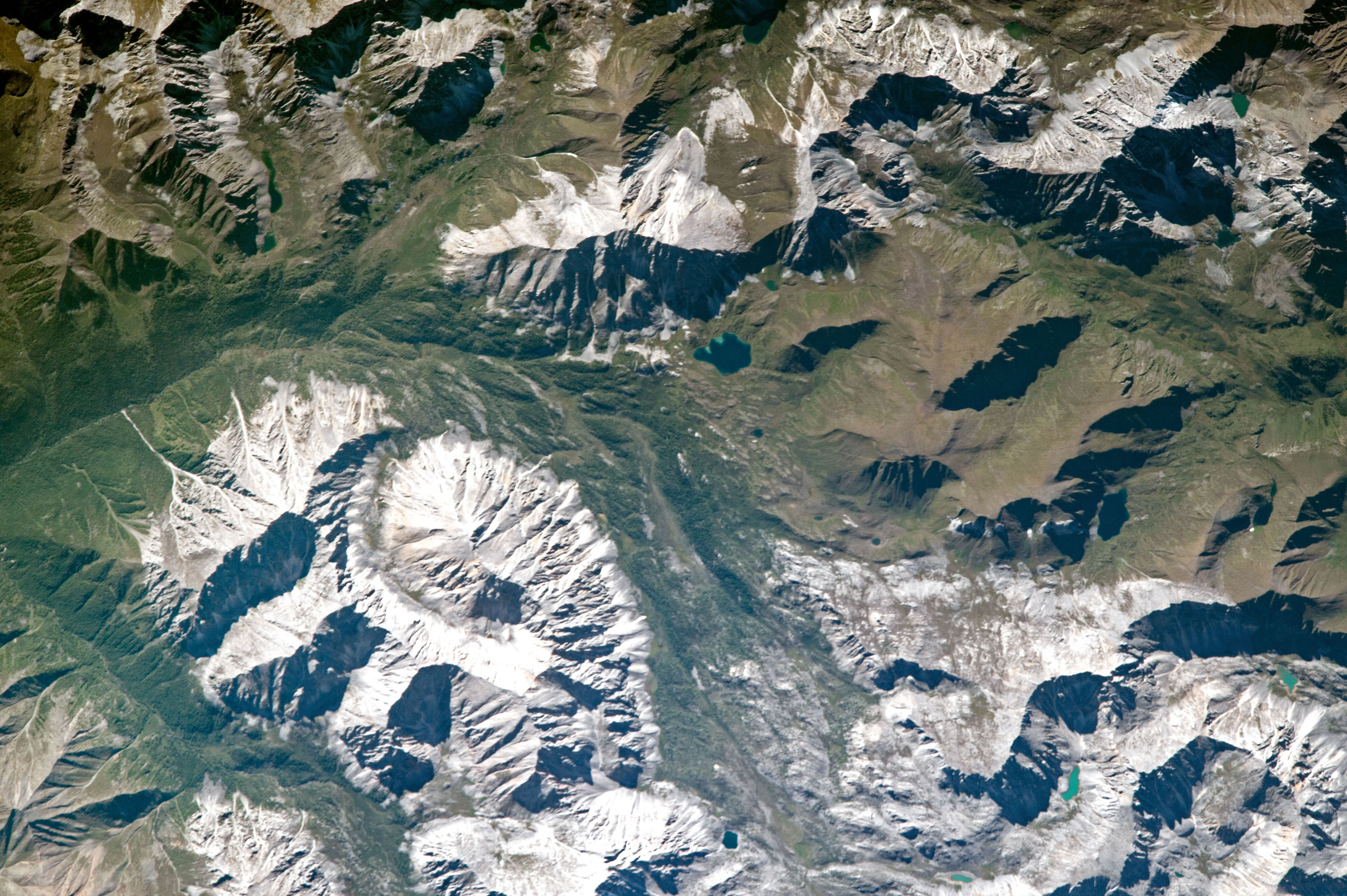 Today's Image of the Day comes from the NASA Earth Observatory and features a look at the Sayan Mountains located in northern Mongolia.