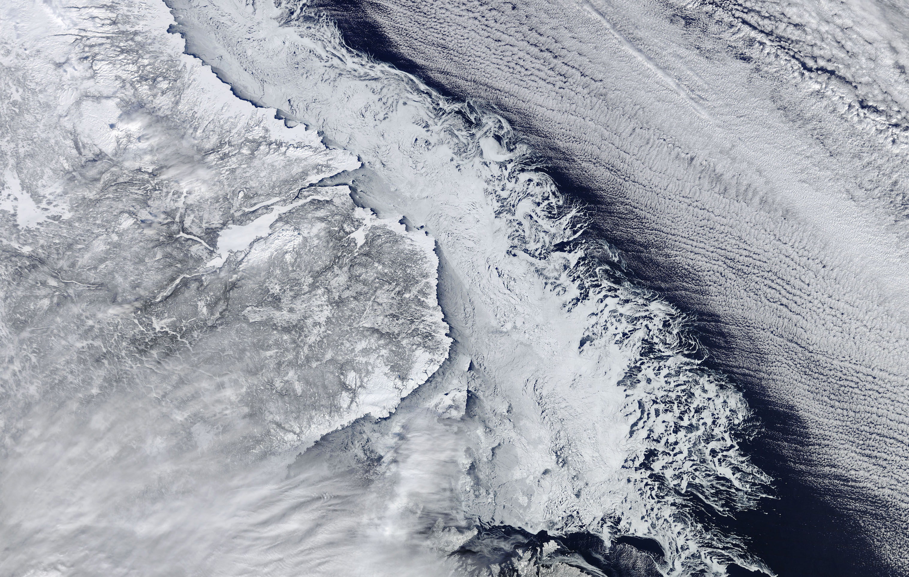 Today's Image of the Day comes from the NASA Earth Observatory and features a look at land ice and sea ice converging along the coast of Newfoundland.