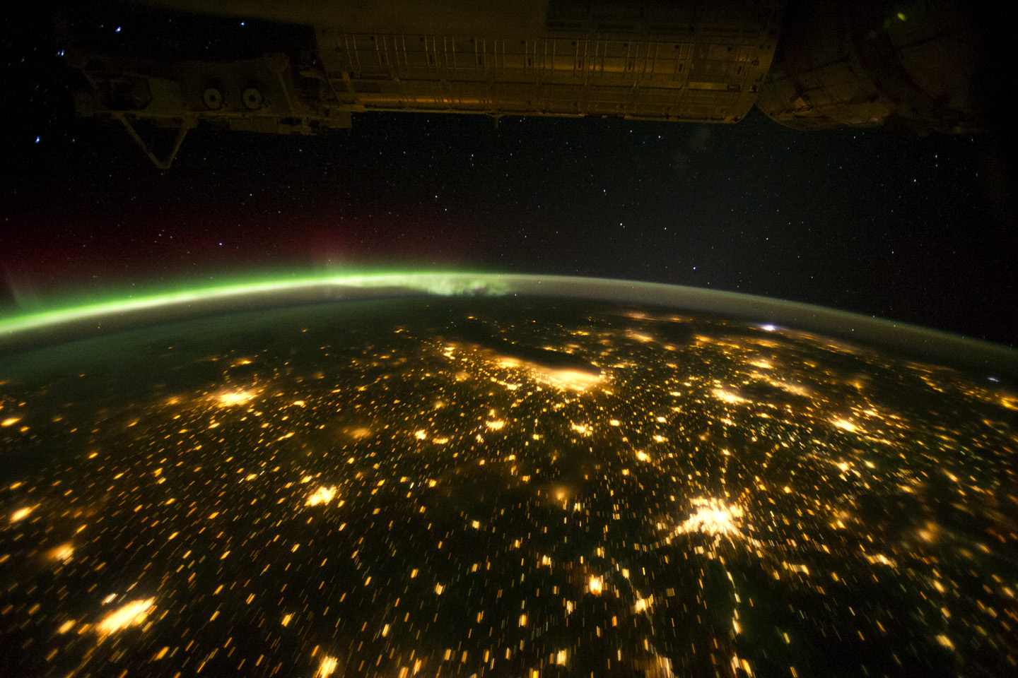 Today's Image of the Day comes from the NASA Earth Observatory and features a look at the aurora borealis glowing over the midwestern United States.