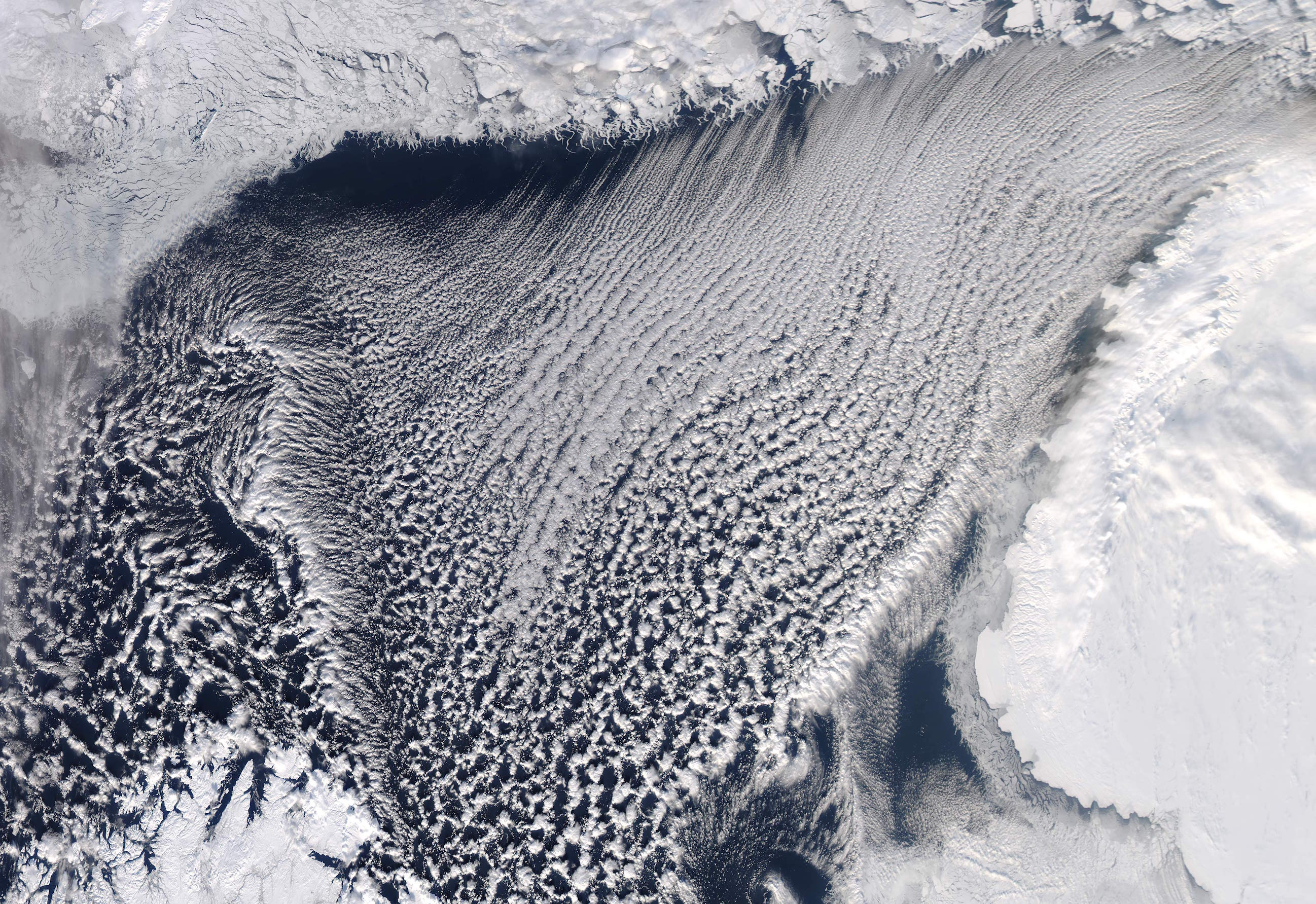 Today's Image of the Day comes from the NASA Earth Observatory and features a look at cloud streets and sea ice extent in the Barents Sea.