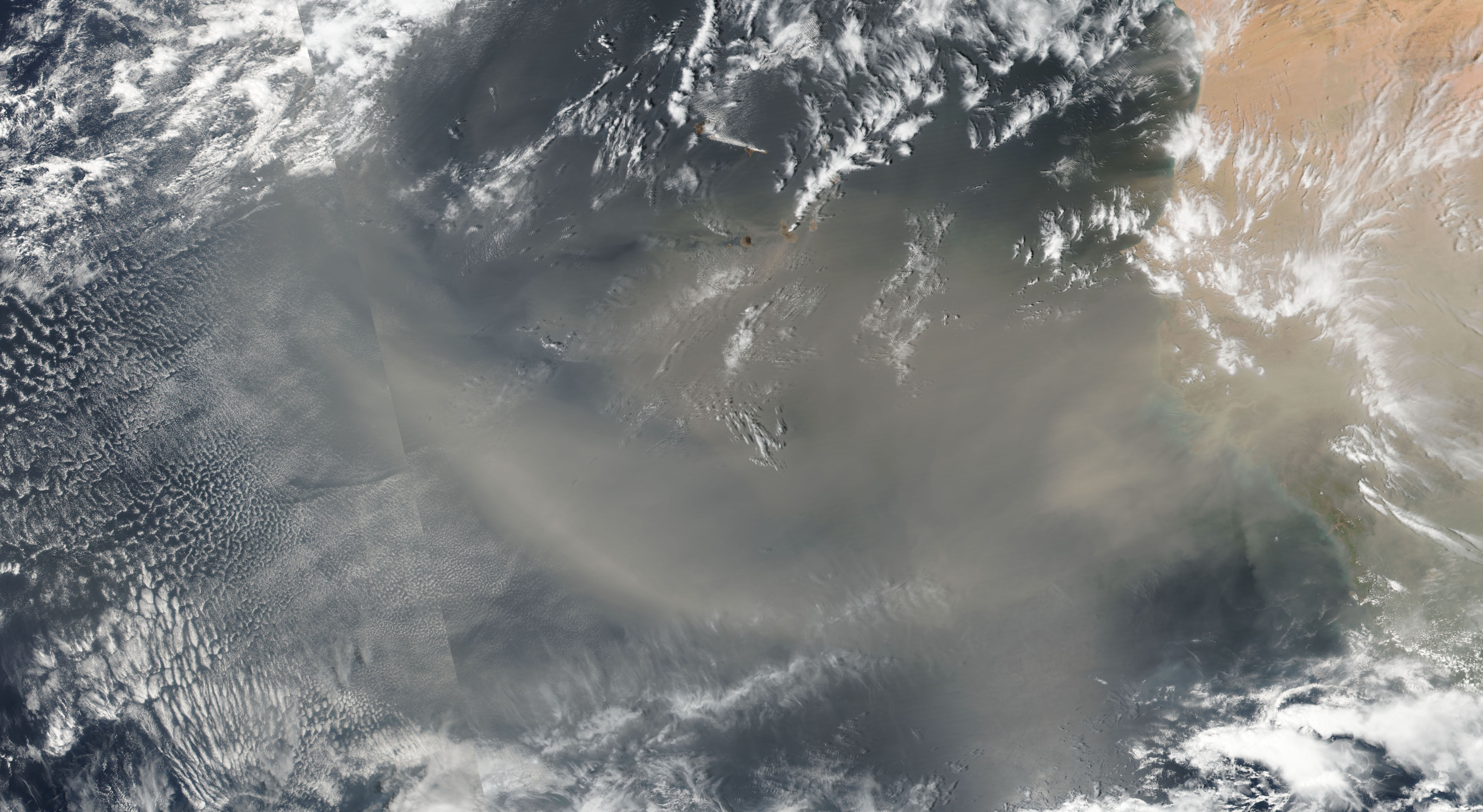 Today's Image of the Day comes from the NASA Earth Observatory and features a look at dust from the Sahara Desert being carried over the Atlantic Ocean.