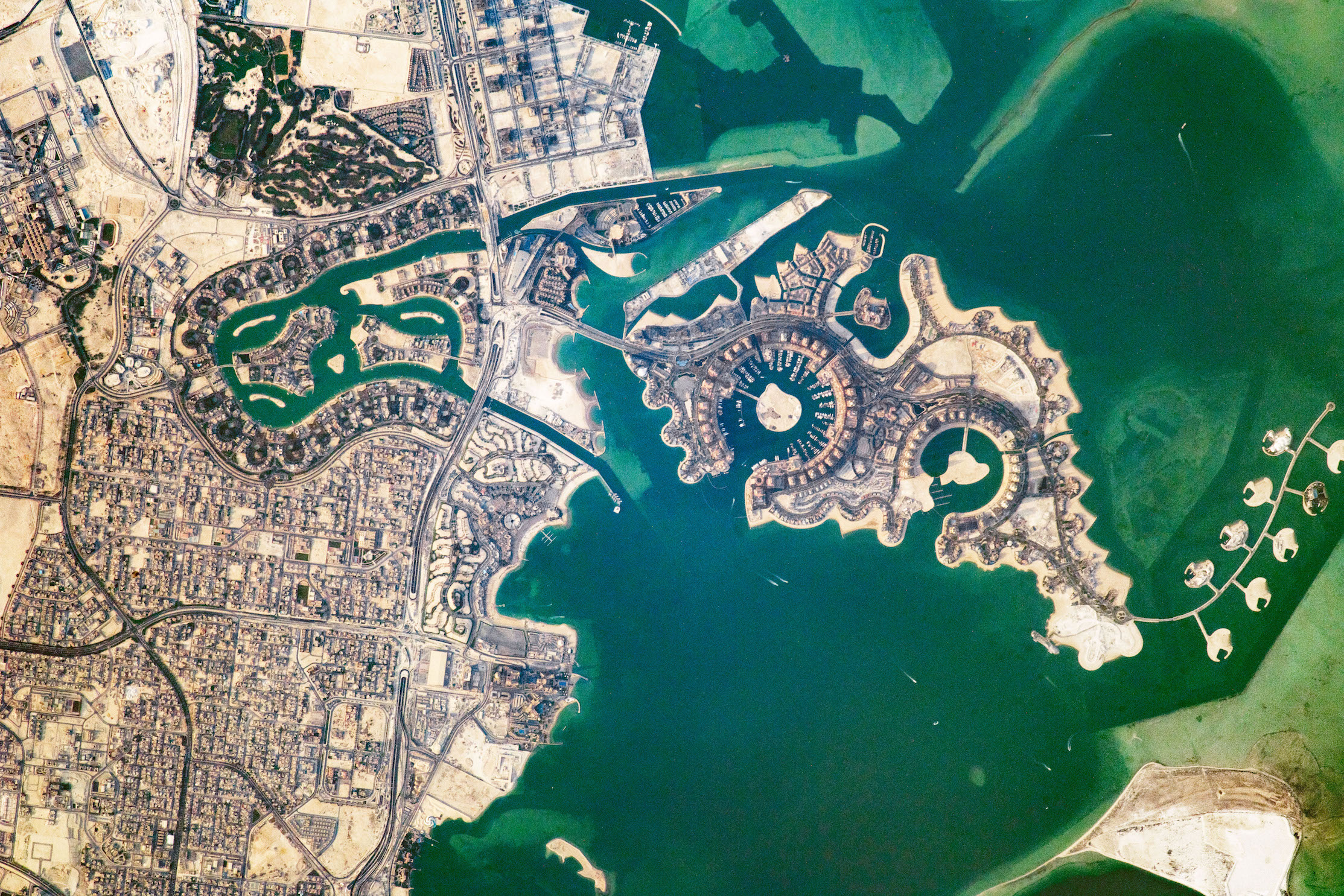 Today's Image of the Day comes from the NASA Earth Observatory and features a look at the Pearl-Qatar, a man-made island in Dohna, Qatar that extends into the Persian Gulf.