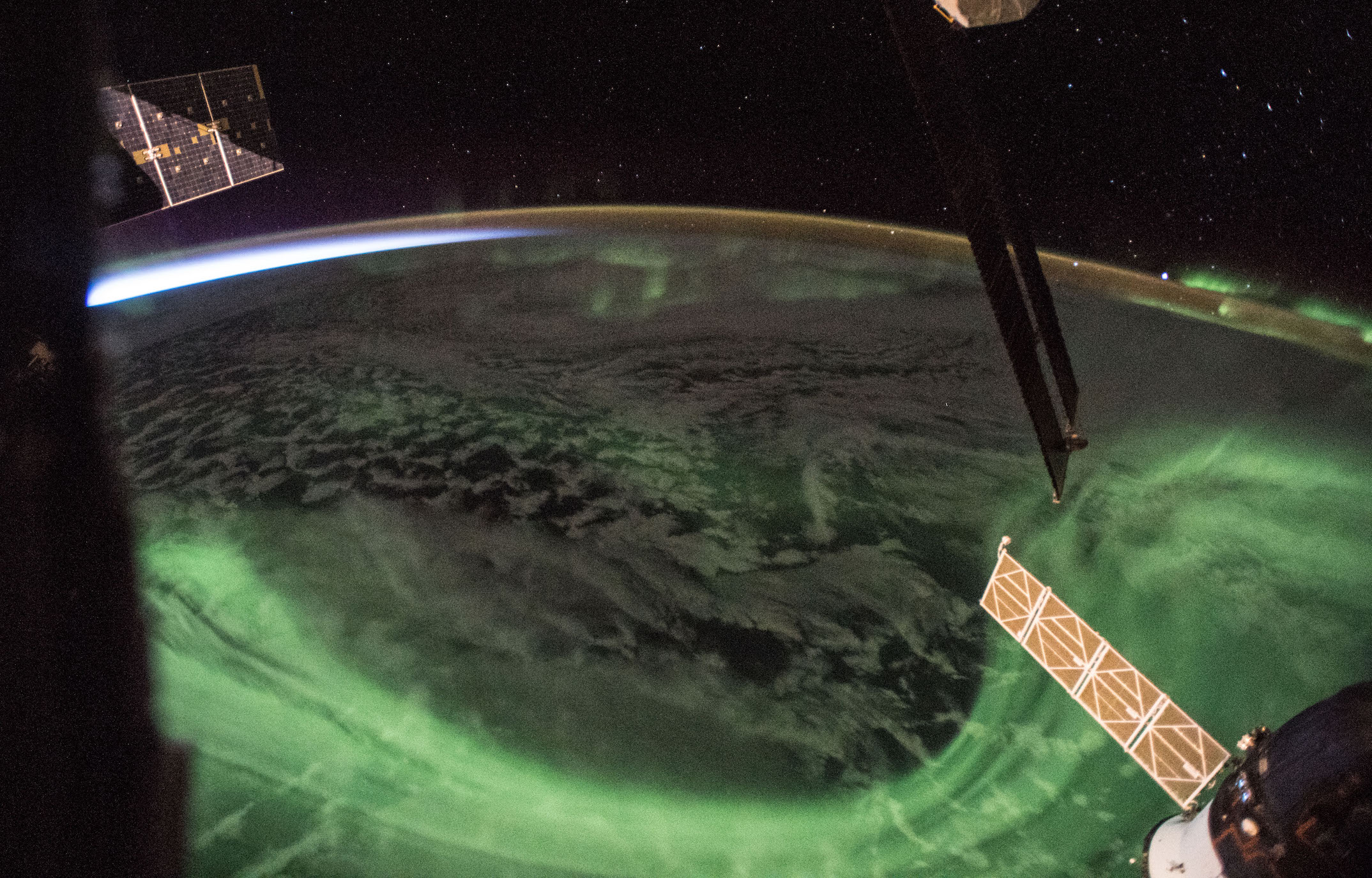 Today's Image of the Day comes from NASA and features an incredible view at a glowing aurora captured at as the sun began to rise.