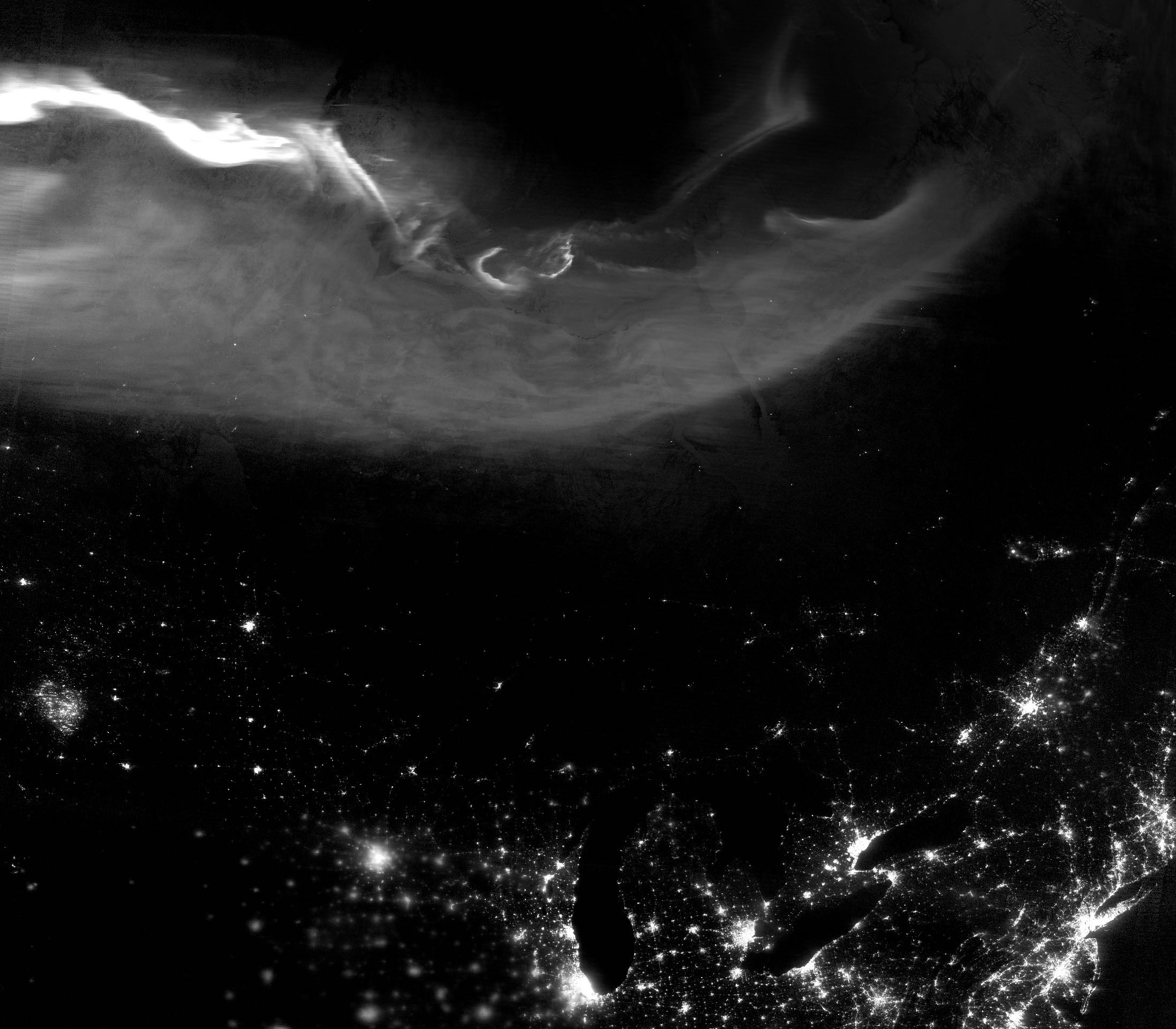 Today's Image of the Day comes from the NASA Earth Observatory and features a look at the aurora borealis lighting up the night sky over North America.