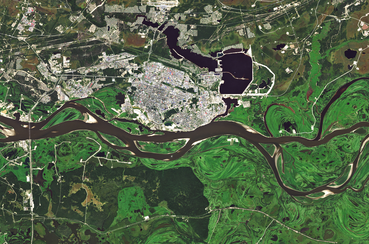 Today's Image of the Day comes from the NASA Earth Observatory and features a look at the incredibly lush and green vegetation that surrounds the Russian settlement of Surgut.