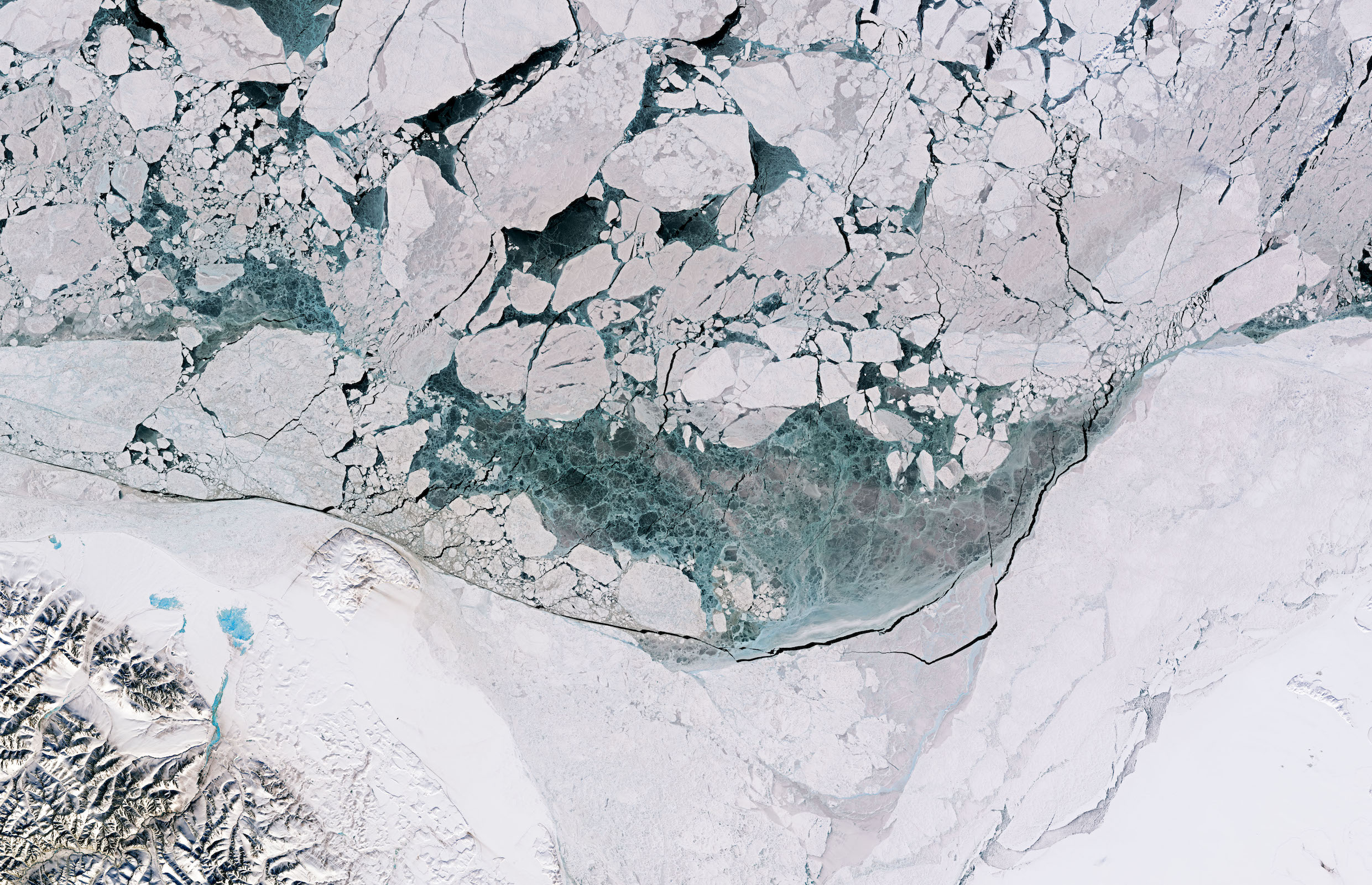 Today's Image of the Day comes from the NASA Earth Observatory and features a look at ice melting along the Beaufort Sea as a result of warming spring temperatures.