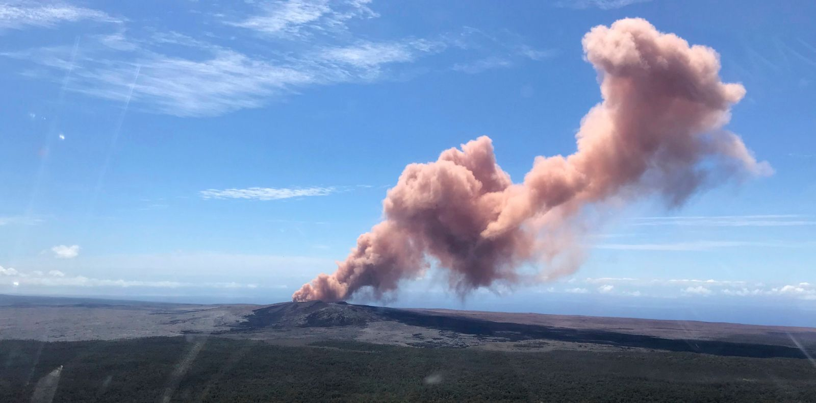 The Kilauea volcano on Hawaii's Big Island erupted late Thursday afternoon with lava spewing into residential areas and cutting through the forest.
