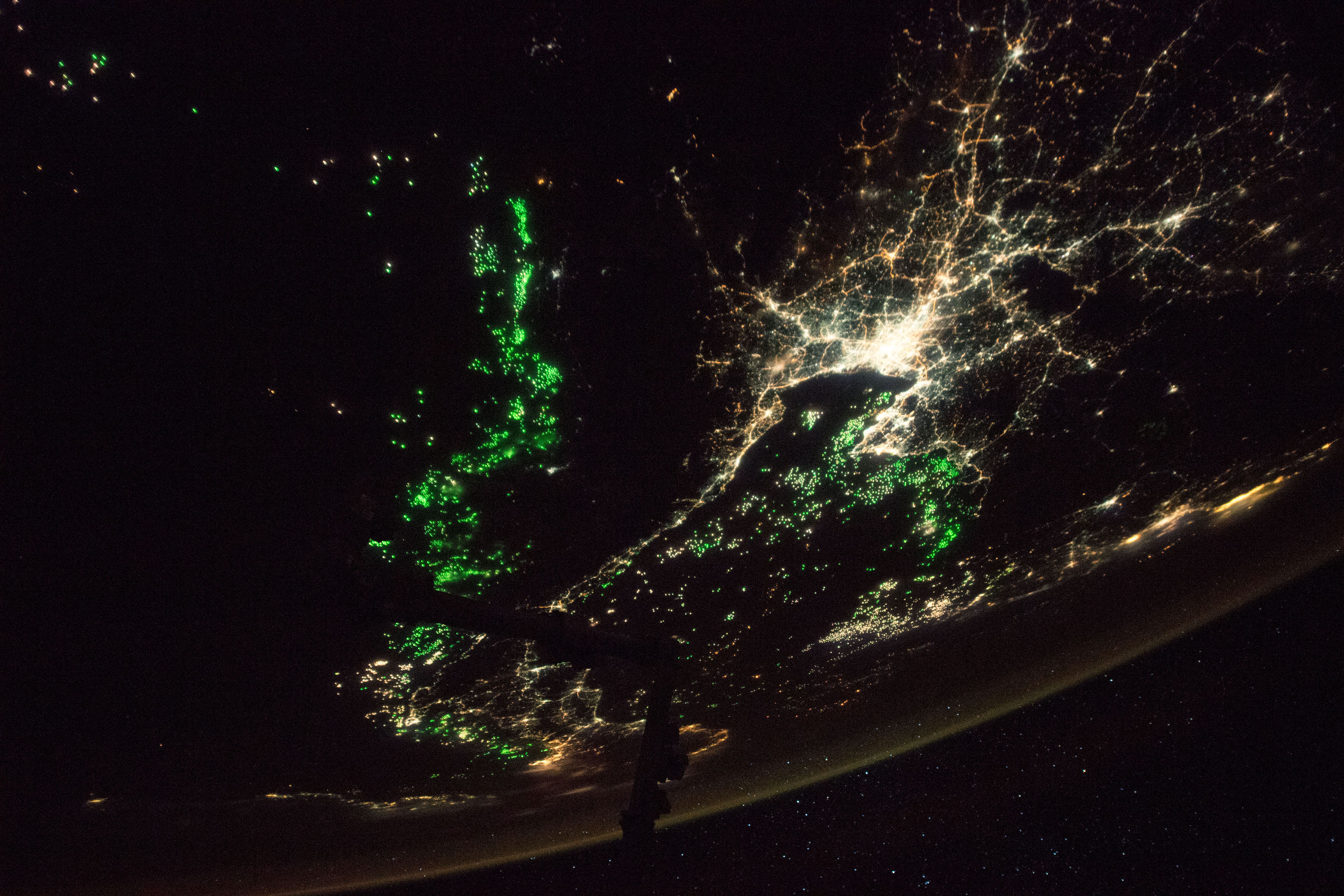 Today's Image of the Day comes from the NASA Earth Observatory and features a look at the city of Bangkok lit up by city lights and fishing boats.