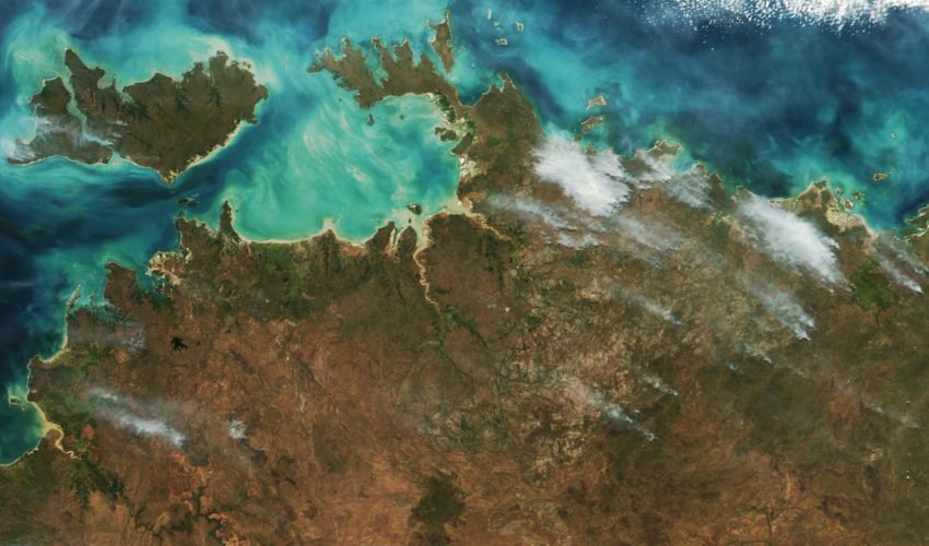 Today's Image of the Day comes from the NASA Earth Observatory and features a look at wildfires blowing smoke over the coast of Australia's Northern Territory.
