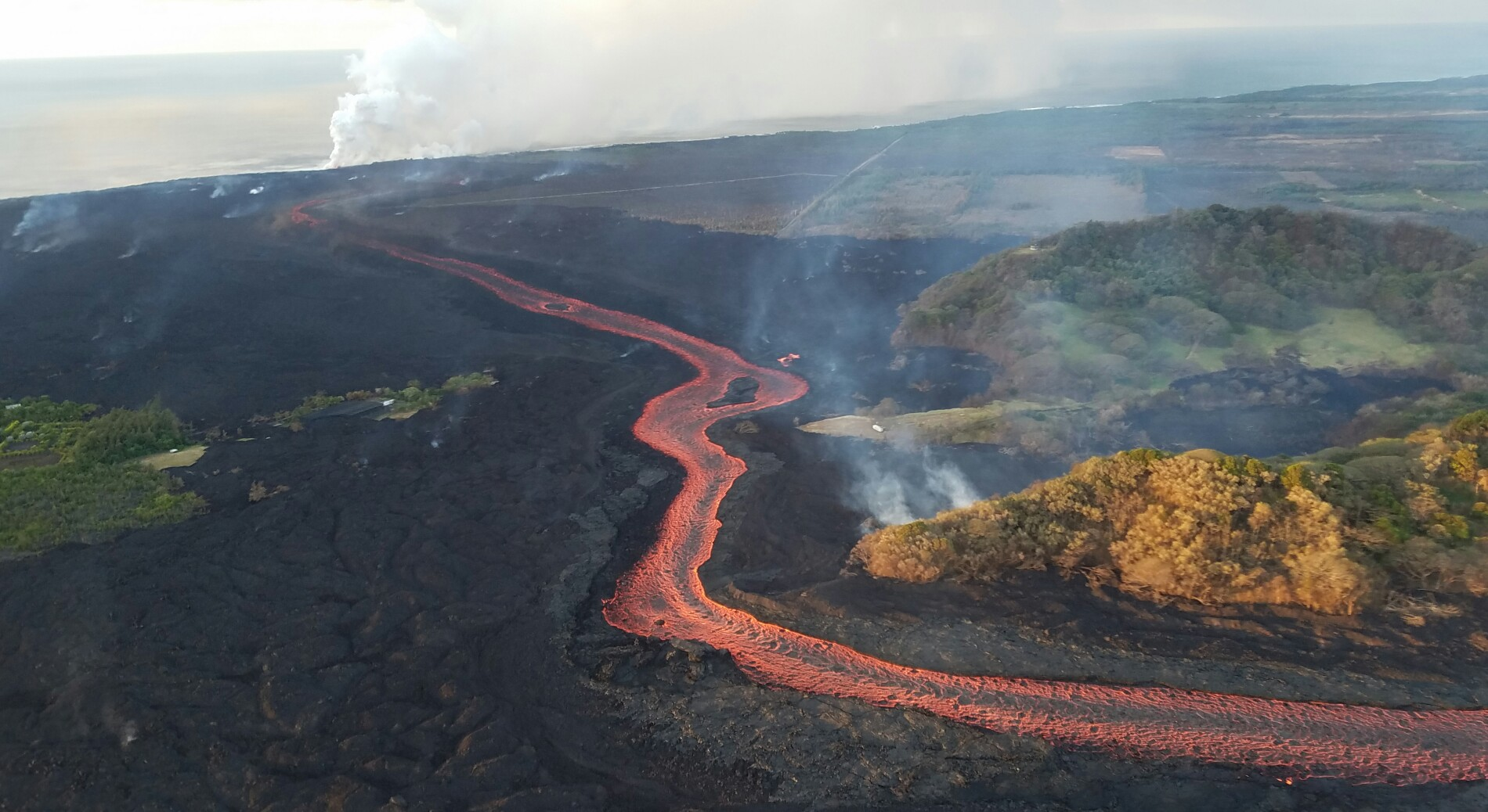 Today's Image of the Day from the U.S. Geological Survey (USGS) shows the river of lava released by fissure 8 as it continues to flow through a well-established channel of scorched Earth.